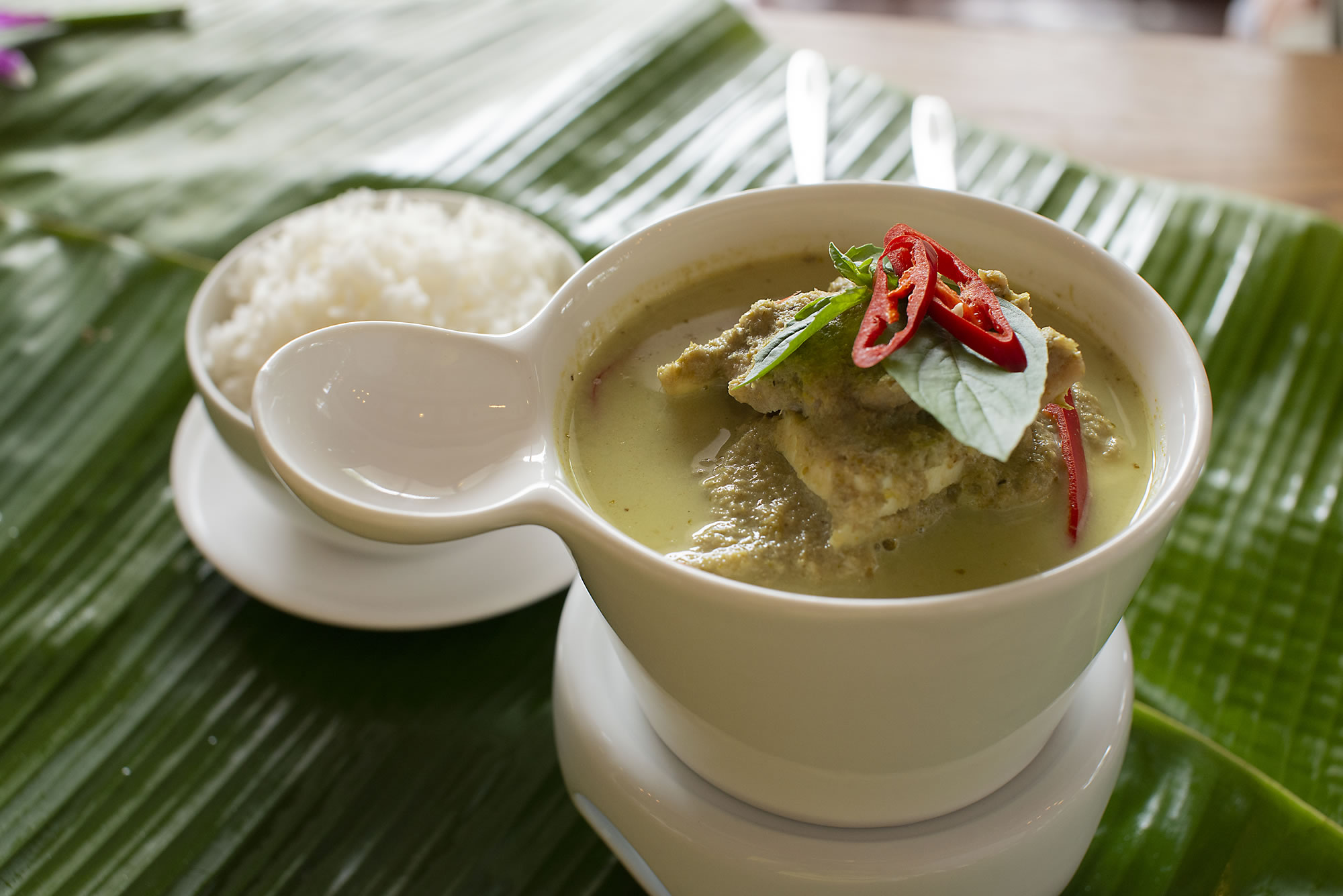 GAENG KIEW WAN GAI/MOO -  Thai green curry with chicken or pork, served with rice