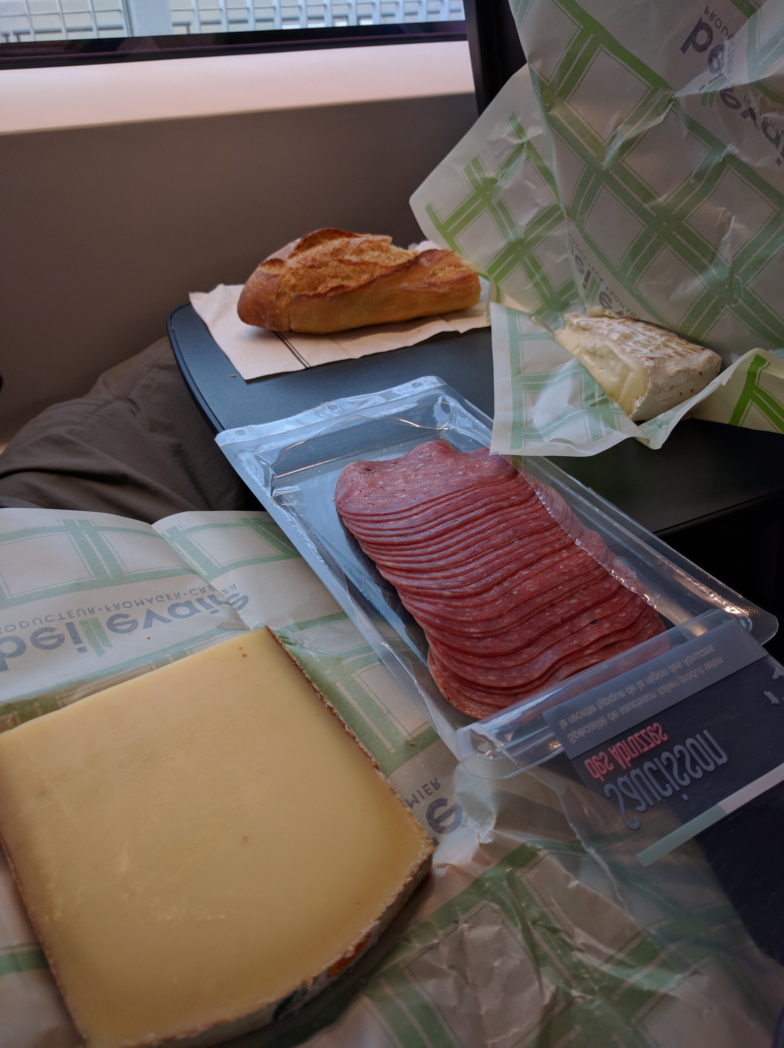 We took some of France with us on the train ride back to London. I had Jeff a little nervous because right before we were supposed to be at the train station we walked a few blocks in search of a Fromagerie (cheese shop). At the shop we bought some brie de melun and   comté to go with our French   baguette  and salami. Yum!