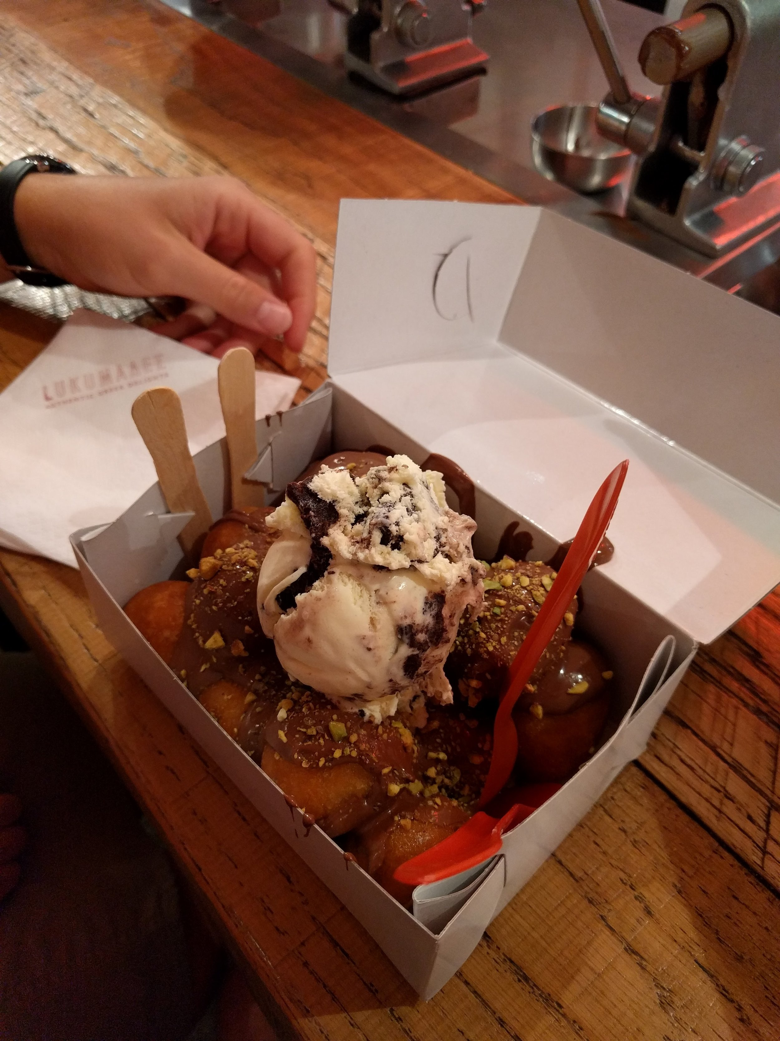 Lukumades in Athens - donut balls with chocolate sauce and cookies and creme ice cream.