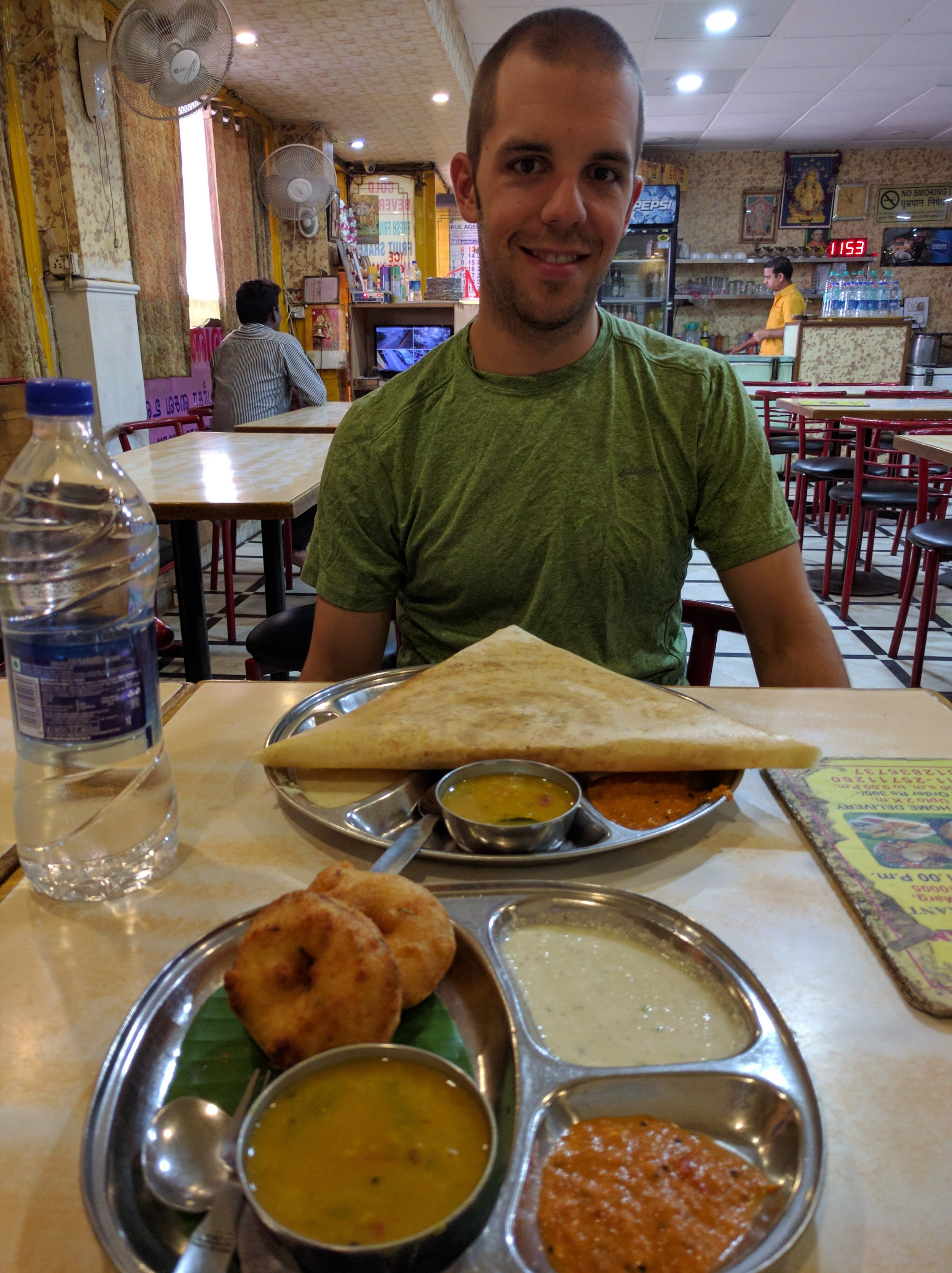 Before coming to here, I don't think Jeff had ever tried Indian food. This picture is of our breakfast in Delhi. We wandered into a vegetarian resturant and ordered vada (sort of a savory donut), and dosa (the large crepe) stuffed with cooked onion. The food came with lentils (the yellow bowl), and 2 other sauces (no idea what they were).