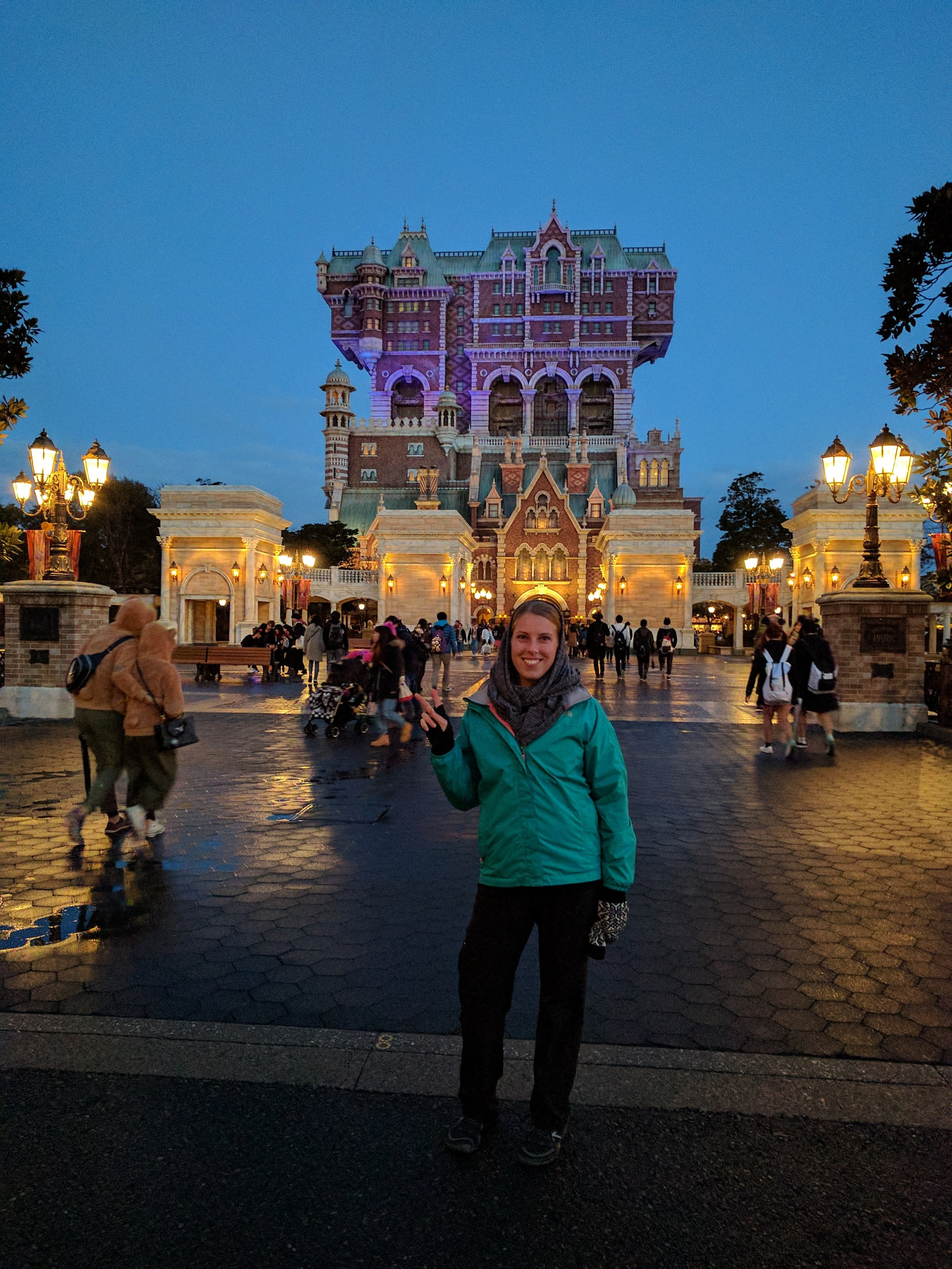 In front of the Tower of Terror, with a proper peace sign