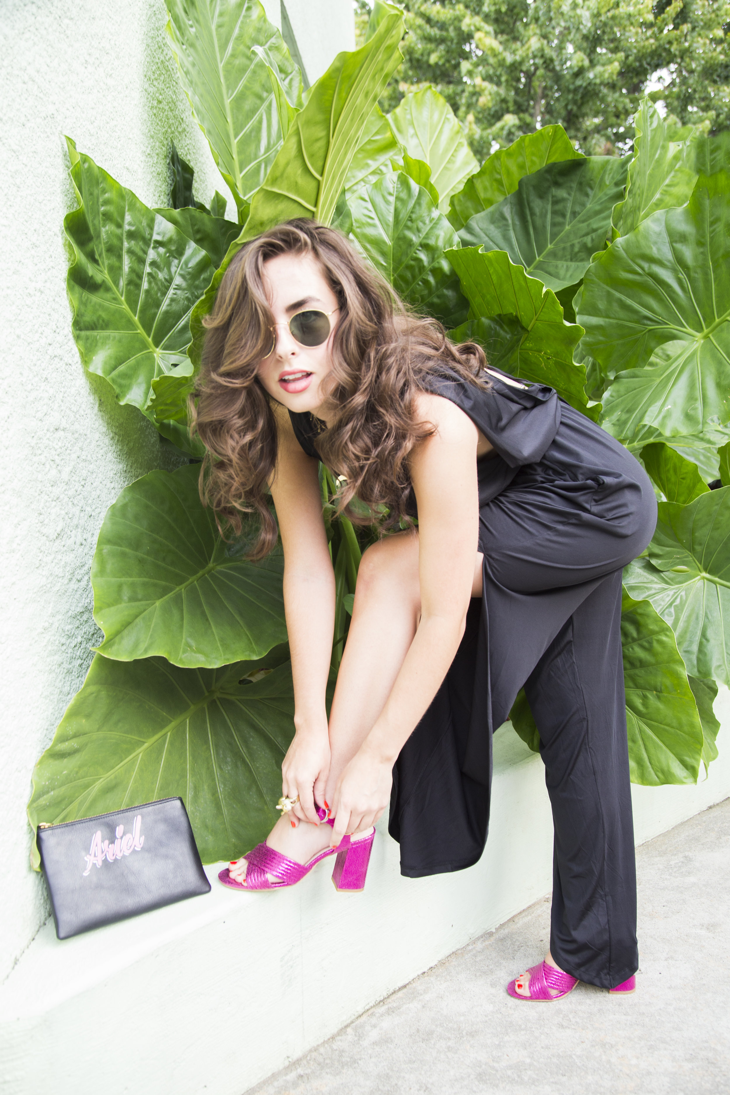 Jumpsuit:  Blush Boutique;  Half-moon necklace:  J & A Wares;  Shoes:  Topshop;  Clutch:  Madewell (personalized by B. Kaspr);  Sunglasses:  Rayban