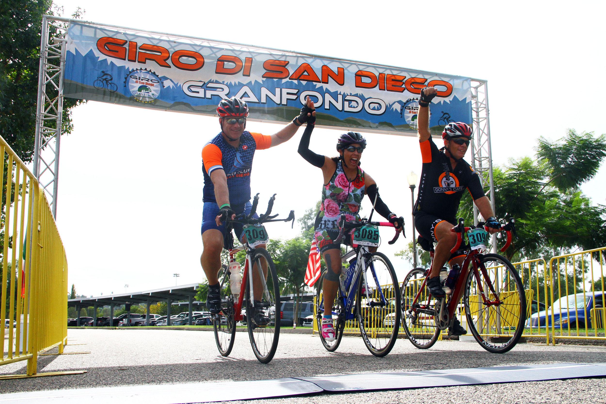 Giro 3 cyclists at finish 2018.jpg