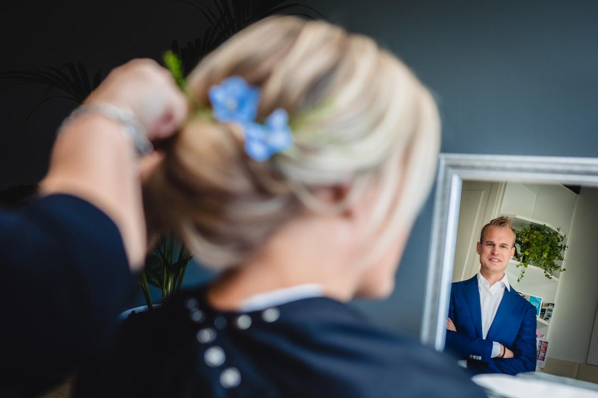 trotse bruidegom bruidsfotograaf