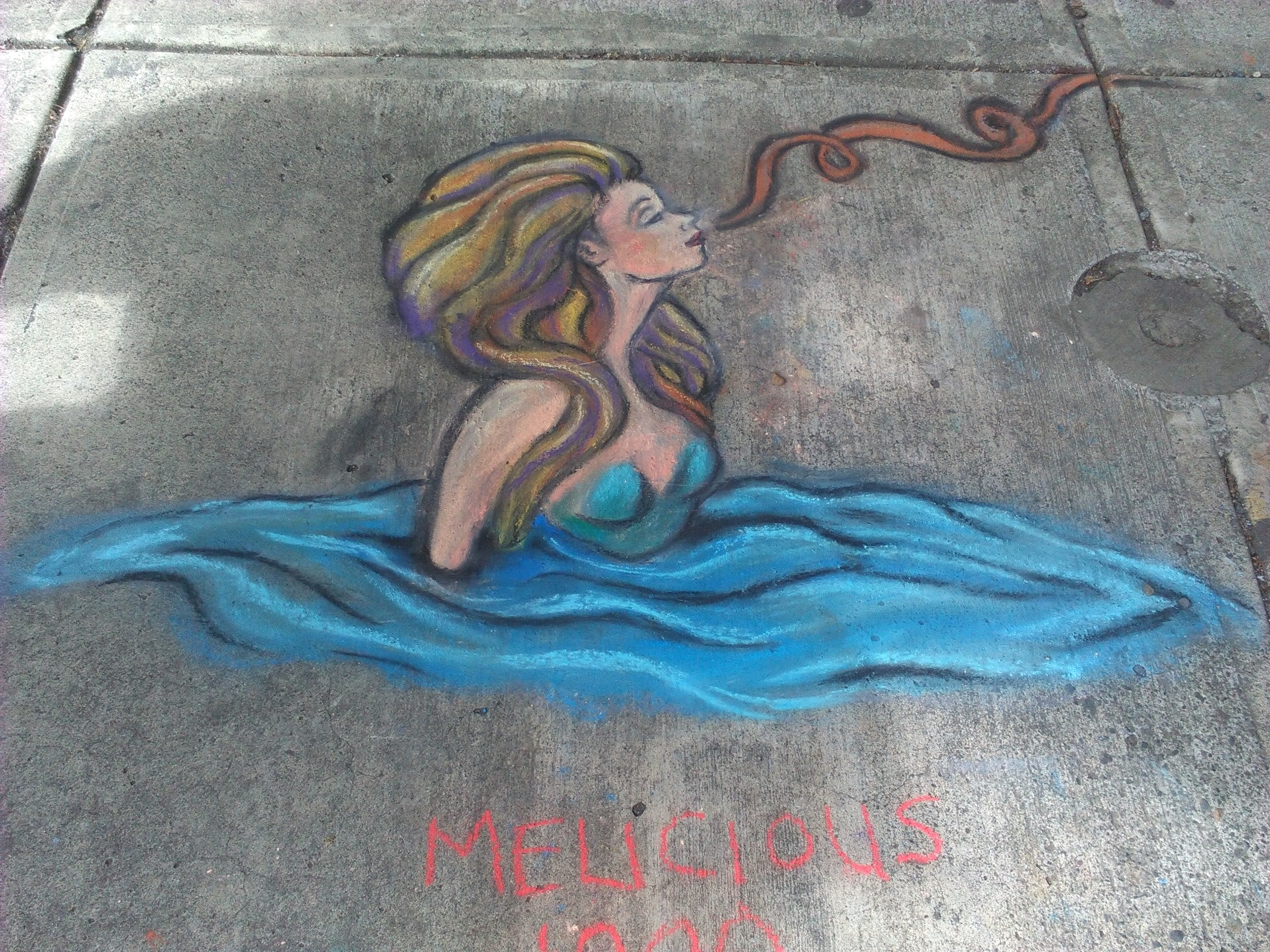 The 2nd drawing where the mermaid sniffs something delicious in the air. Near NW 5th and Couch.