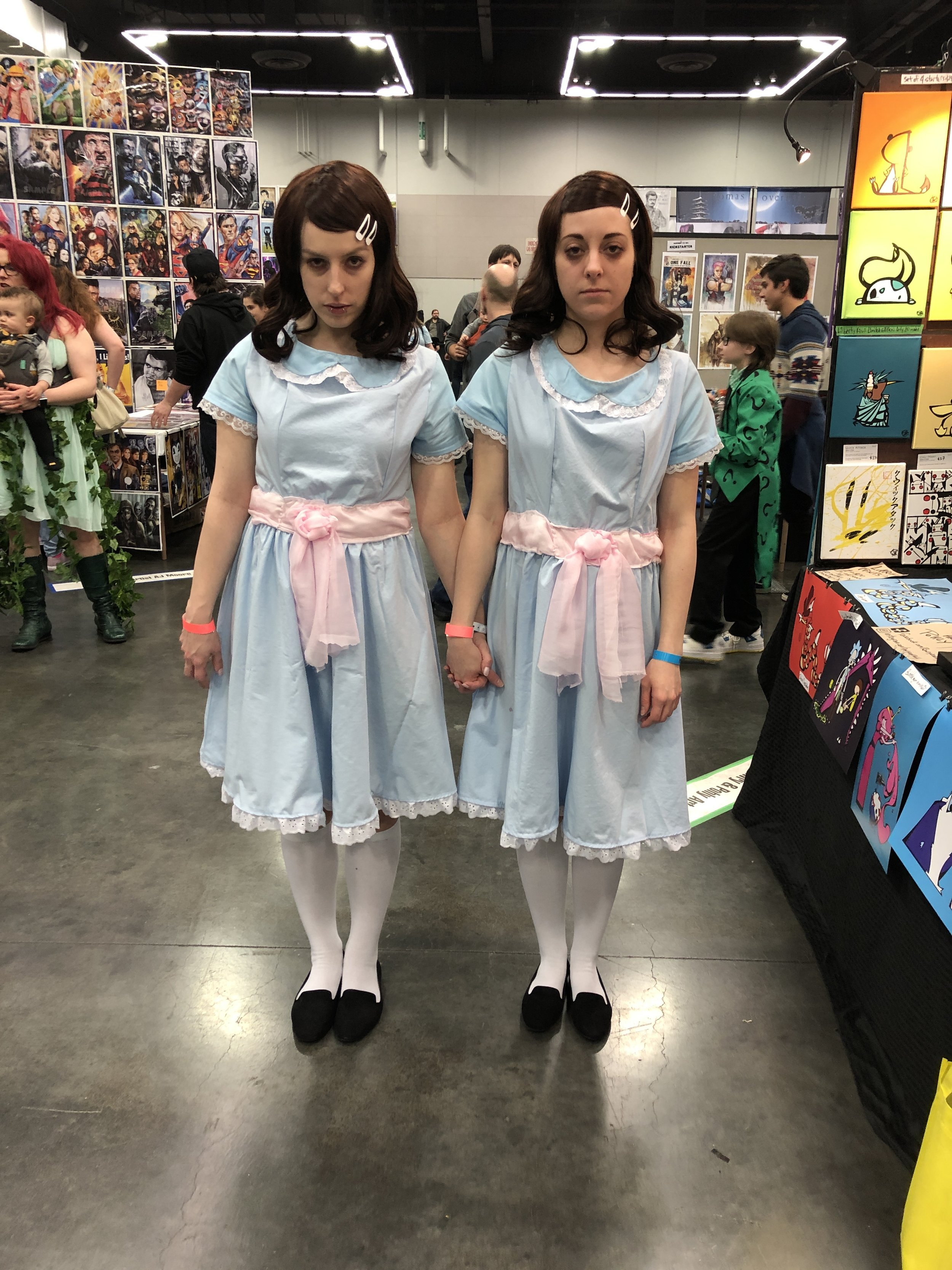 The scary ghost twin cosplayers from the movie, The Shining.