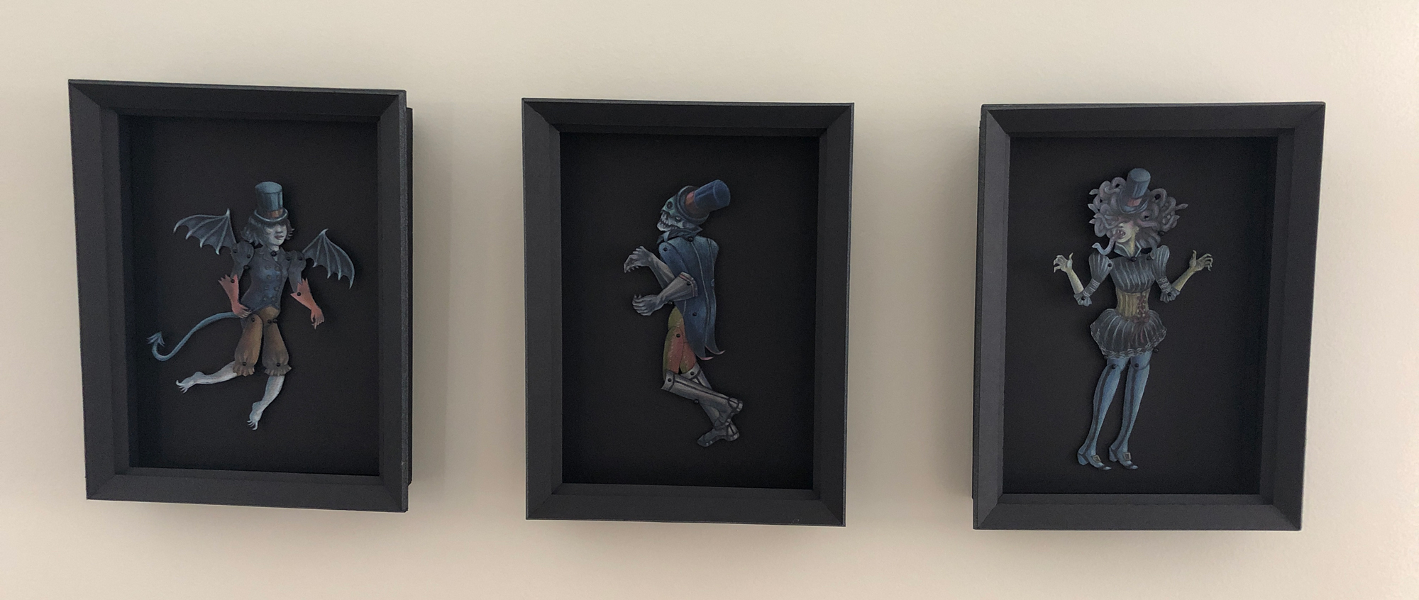 """Each original paper puppet was created with colored pencil and has it's own 9"""" x 11"""" homemade shadow box in which to live, move and play."""