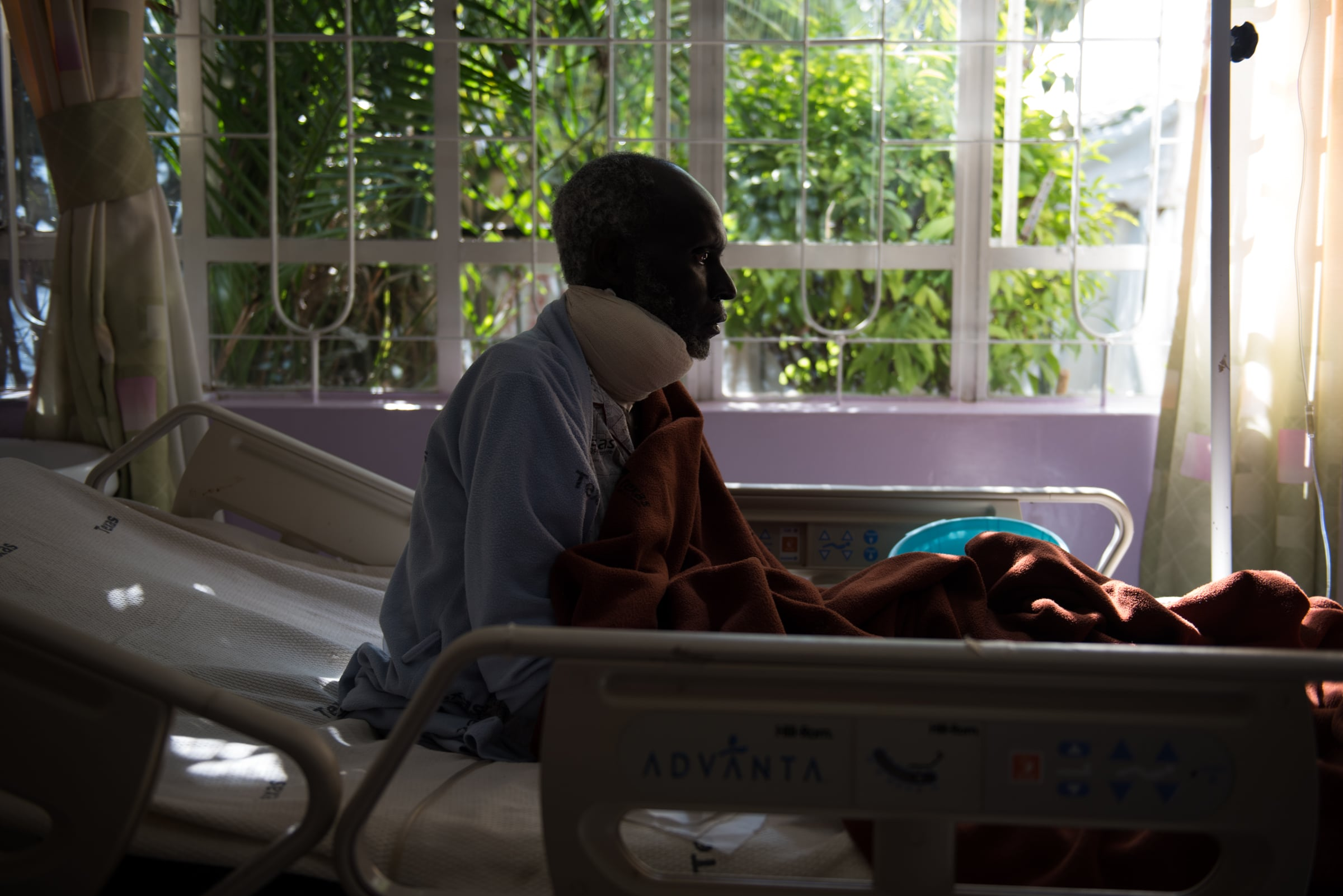 Samwell Mosota Omaiyo sits up in his bed on Sunday afternoon at the Texas Cancer Centre in-patient facility in Nairobi, Kenya on Sunday, Aug. 23, 2015. Nurses here are trained in palliative care and give round the clock care to over a dozen patients in this small medical building.