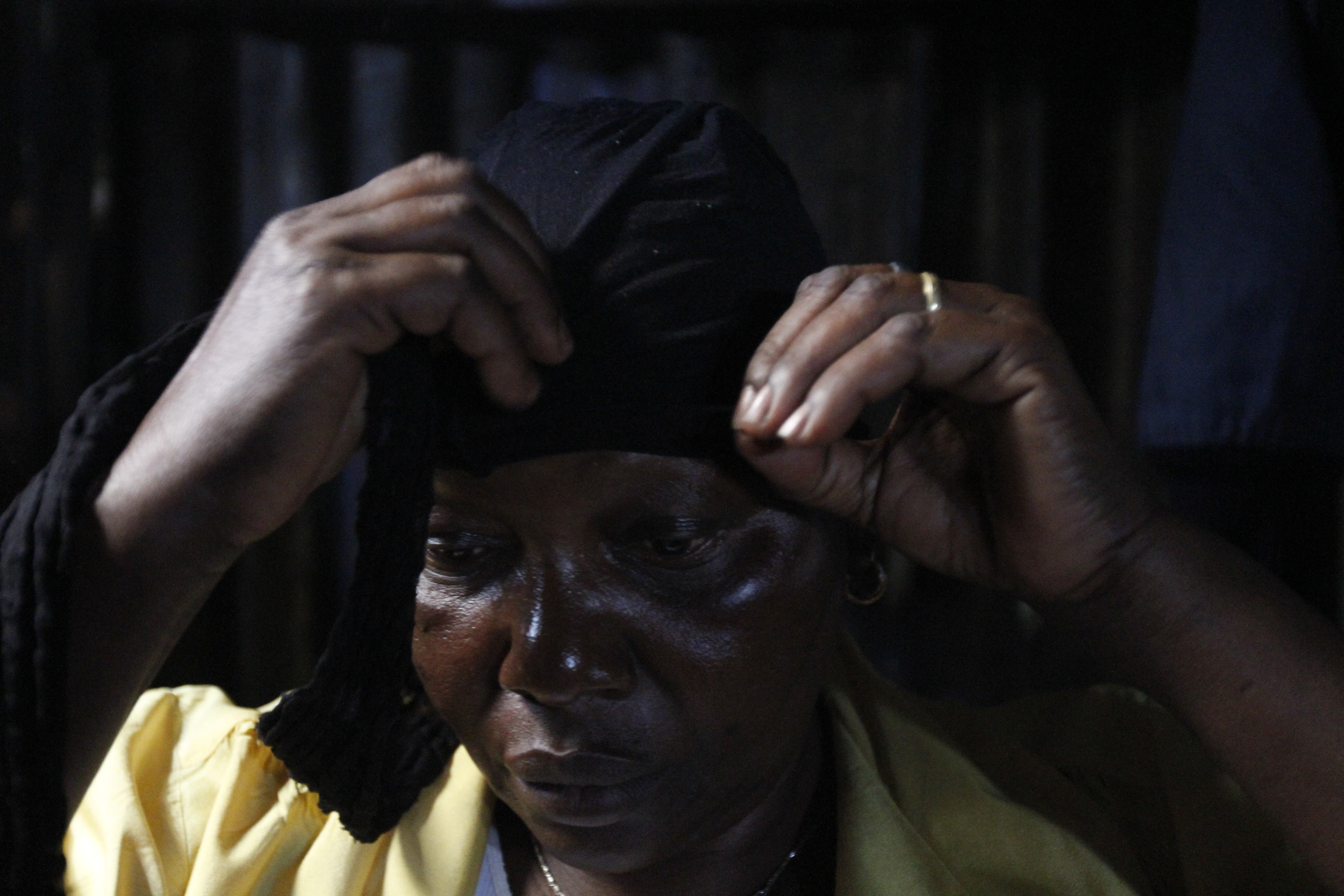 Rosemary ties a head gear to conceal her bald head when she got due to chemotherapy