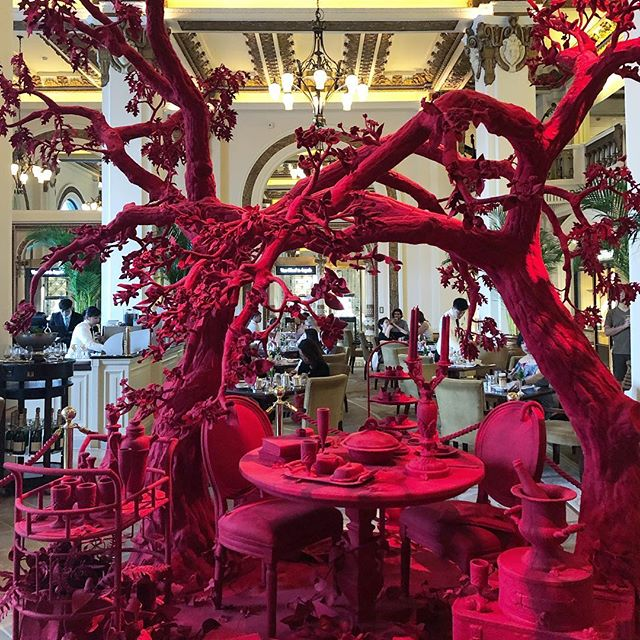 This intriguing installation by Brooklyn-based  @timothypaulmyers juxtaposes the classical architecture of @peninsulahongkong with his modern artwork representing and combining every day objects we all can relate to with hospitality experiences by people everywhere. What an interesting way to create this unexpected interior layering by wrapping each object in red felt. Happy I was able to see this in person! . . . #art #thepeninsula #hongkong #modernart #hk #hospitalty #luxury #travel #asia #interiordesign #studiojwdesign