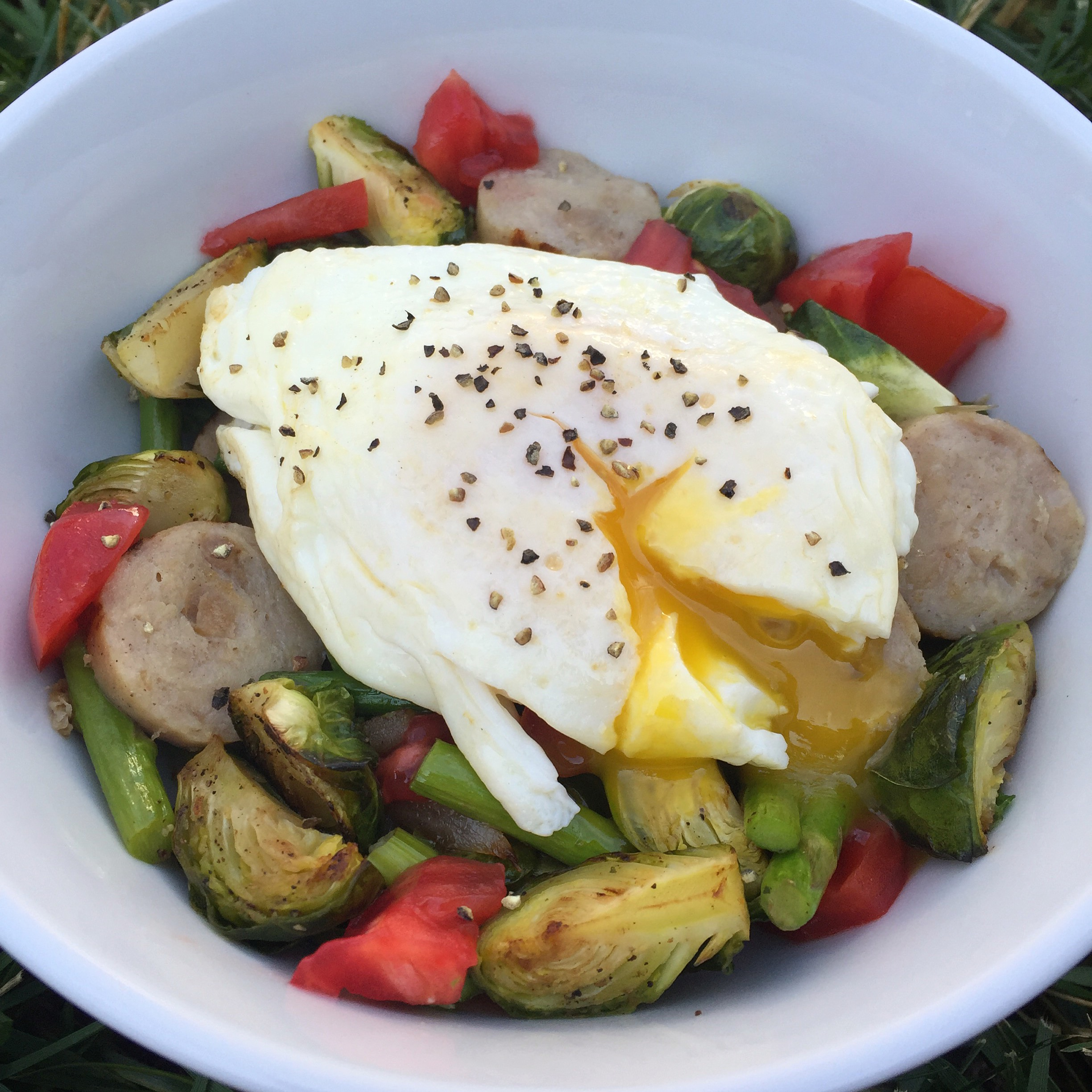 This particular day my egg bowl was filled with potatoes and spinach on the bottom, topped with leftover roasted asparagus and brussel sprouts, onions, a chicken sausage from Trader Joe's, tomatoes, a runny egg, salt/pepper, and a dollop of cottage cheese after I took the picture.