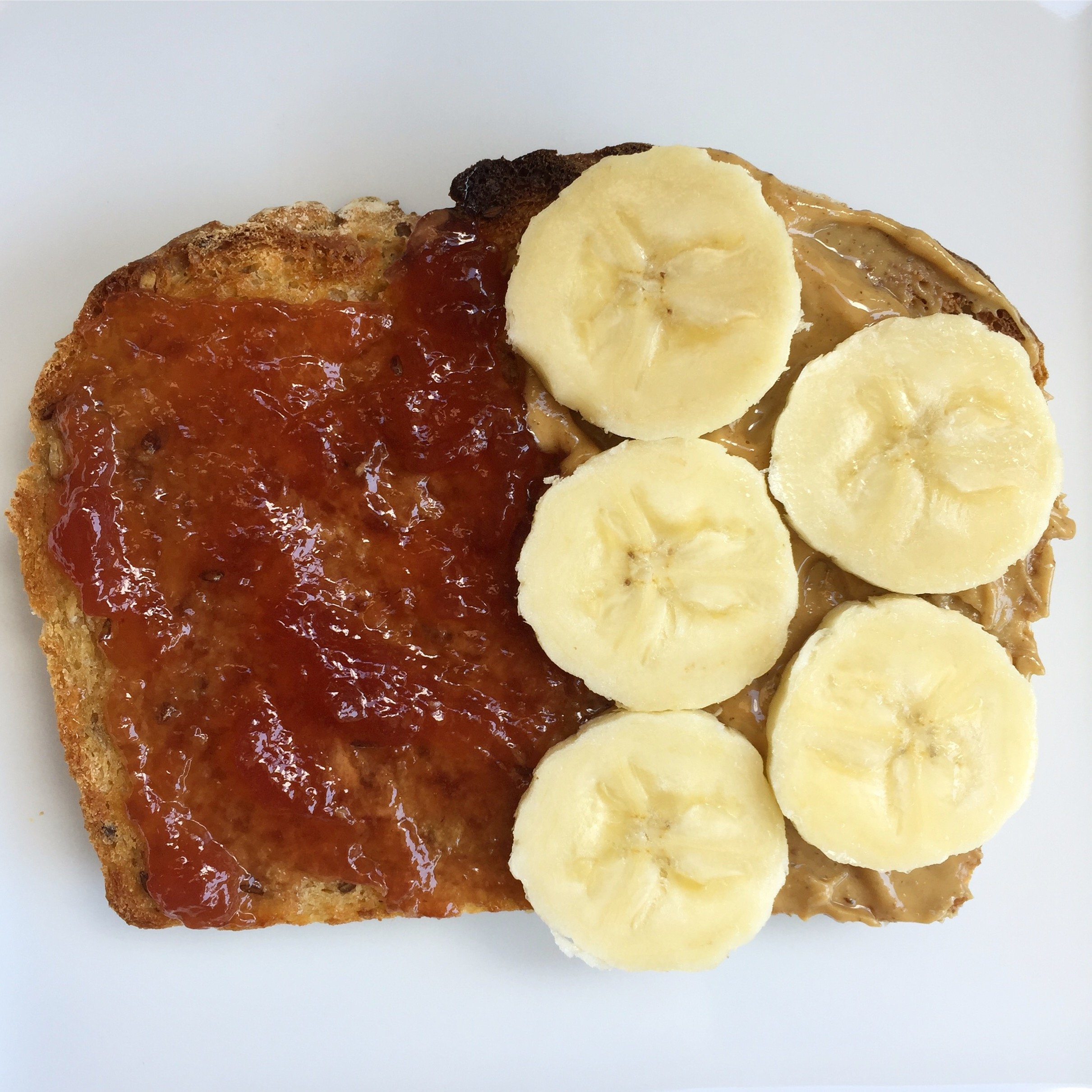 Homemade  whole wheat bread ...1/2 with butter and strawberry jelly + 1/2 with crunchy Peanut Butter and banana