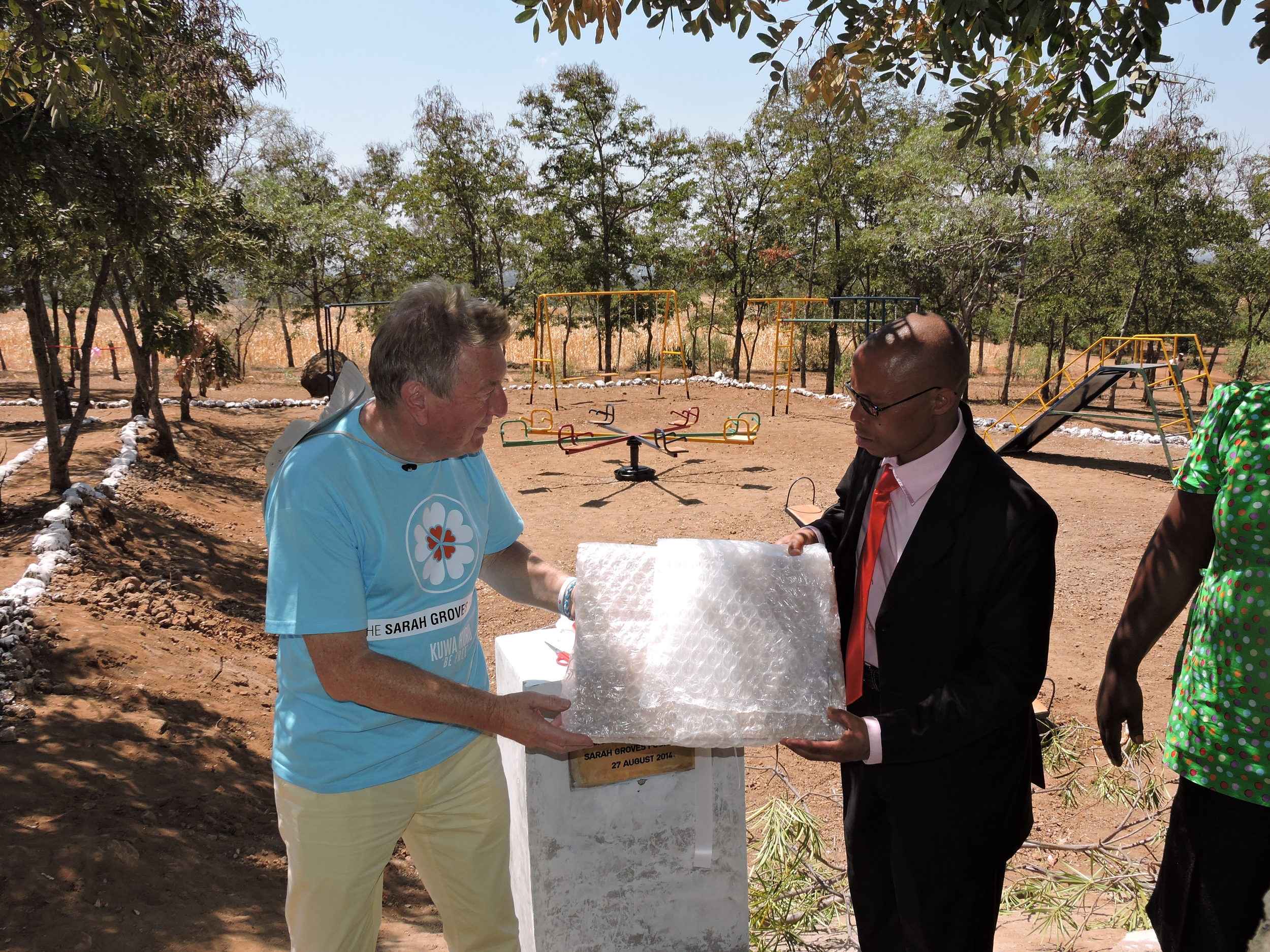 """Presentation and unveiling of plaque which reads """"In loving memory of Sarah Groves, who visited Mgungani School in 2012. Sarah Groves Foundation 27 August 2014"""""""