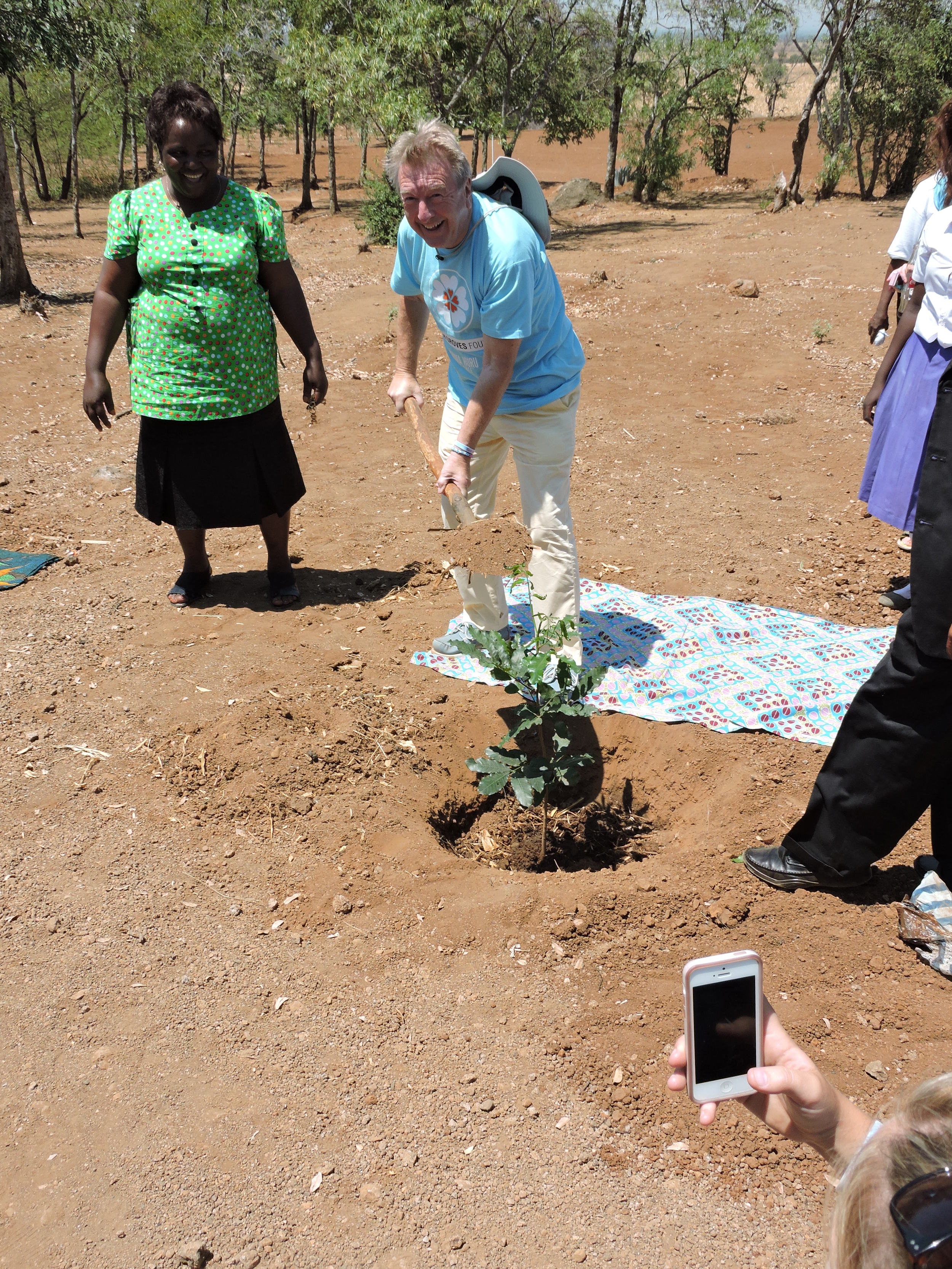 Ceremonial planting of a tree in Sarah's memory by Sarah's father, Vic