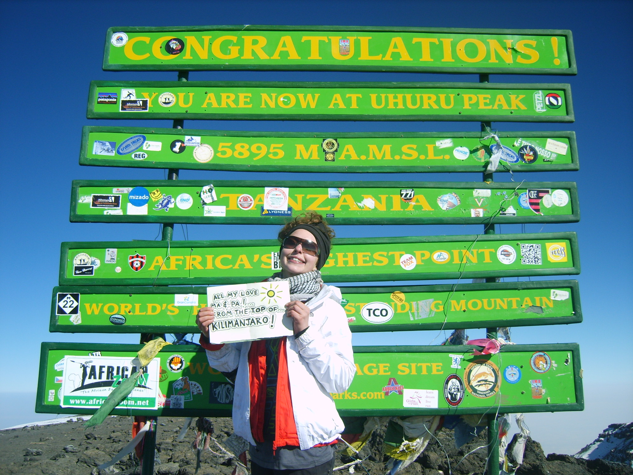 Sarah at the top of Mt. Kilimanjaro with a note to her parents.