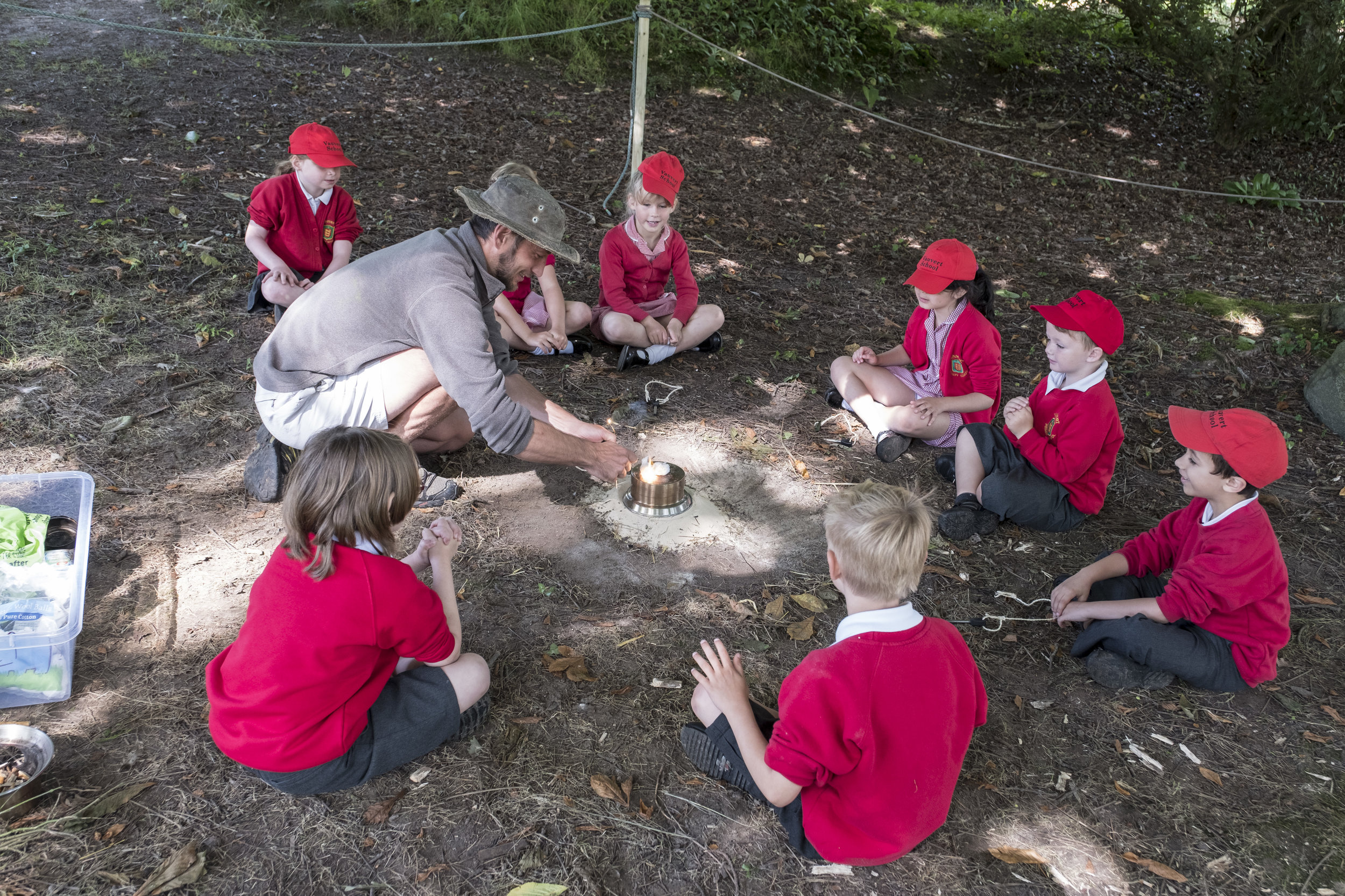 Children being taught primitive bushcraft skills