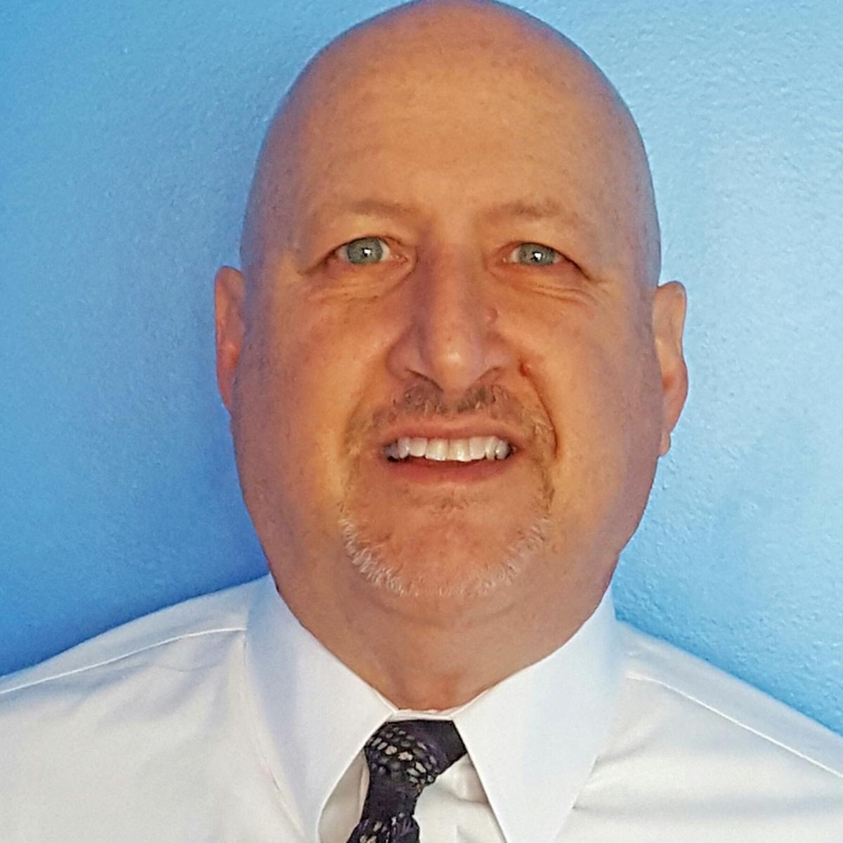 Eric Buckner Headshot Woodcliff Square lower res for website.jpg