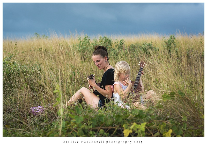 mom and daughter in field with ukuleles © candice macdonnell photography