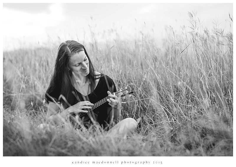 woman playing ukulele in the field © candice macdonnell photography