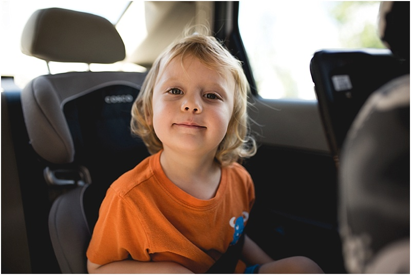 boy riding in car oahu family photographer