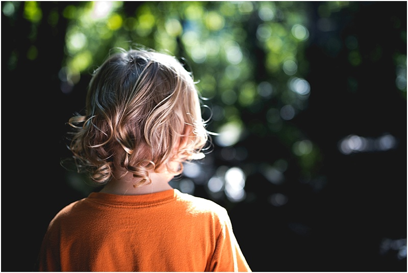 sunlight in child's curls lifestyle family photography