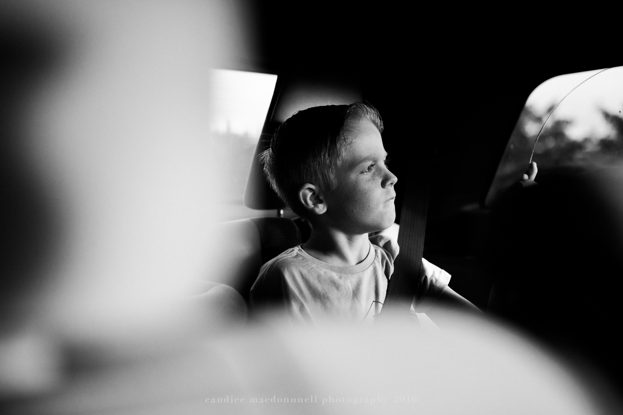 thoughtful child in car lifestyle photography by candice macdonnell photography, oahu hawaii documentary photographer