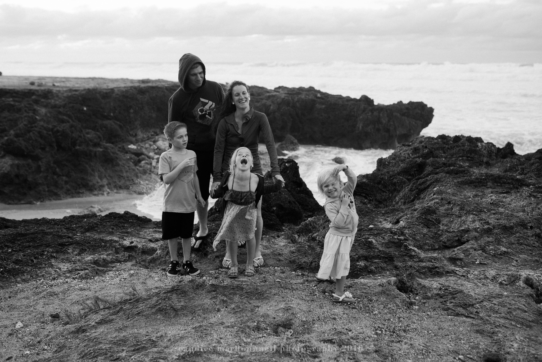best family photograph at kaena point beach lifestyle photography by candice macdonnell photography, oahu hawaii documentary photographer
