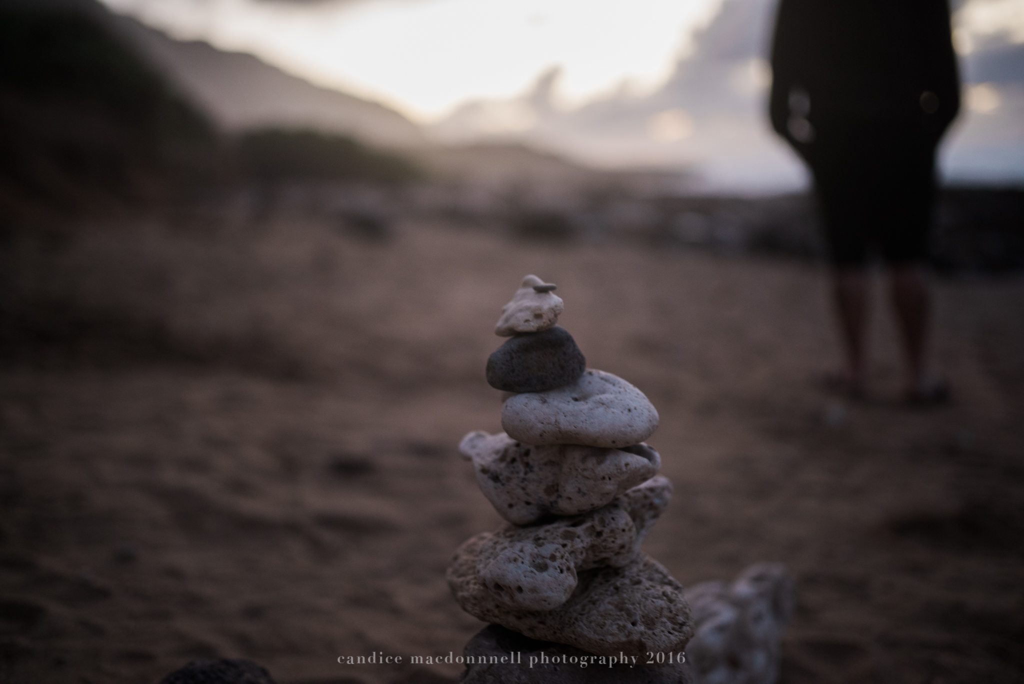 stacked rocks at kaena point beach lifestyle photography by candice macdonnell photography, oahu hawaii documentary photographer
