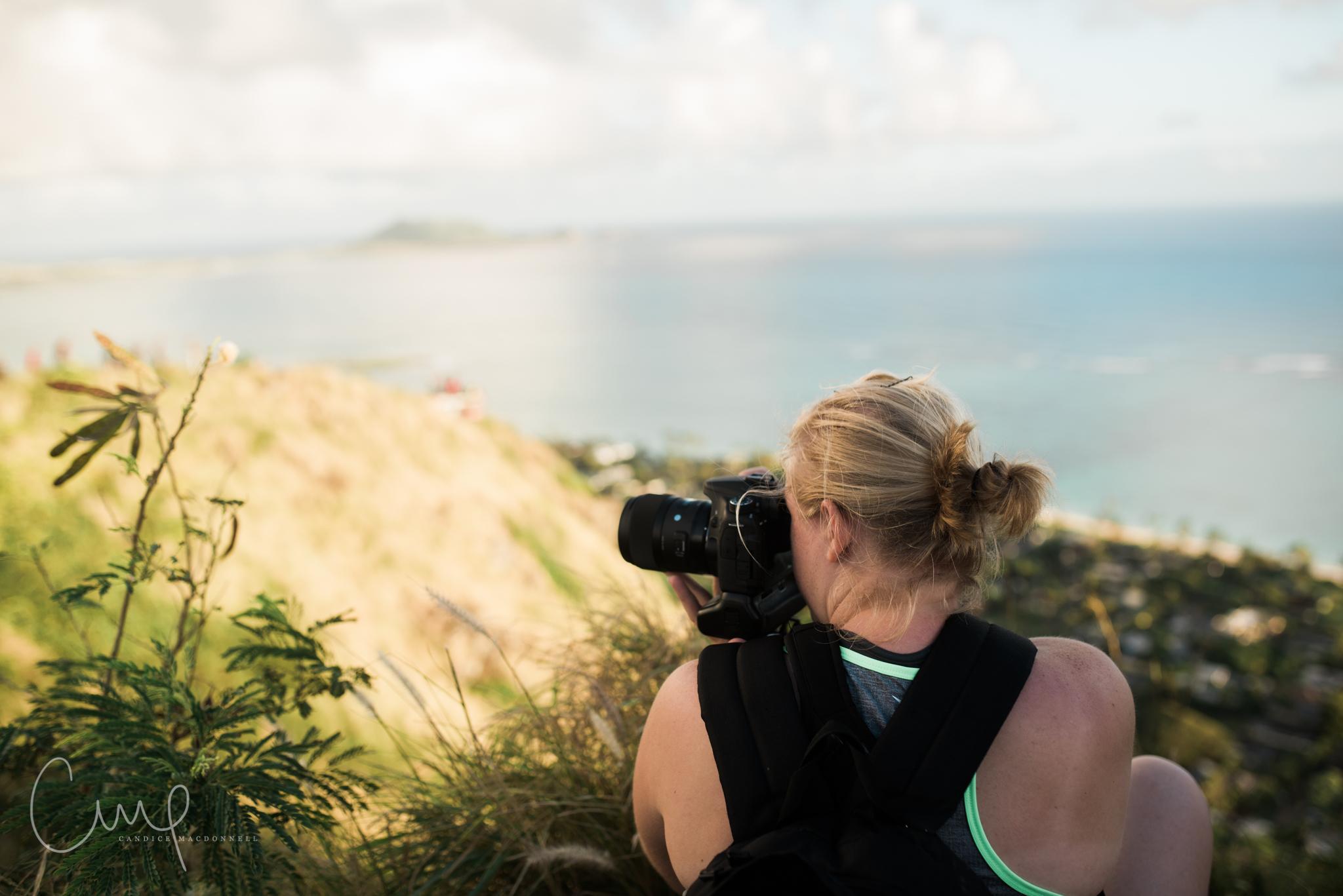 friend taking photos while hiking lanikai pillboxes oahu hawaii