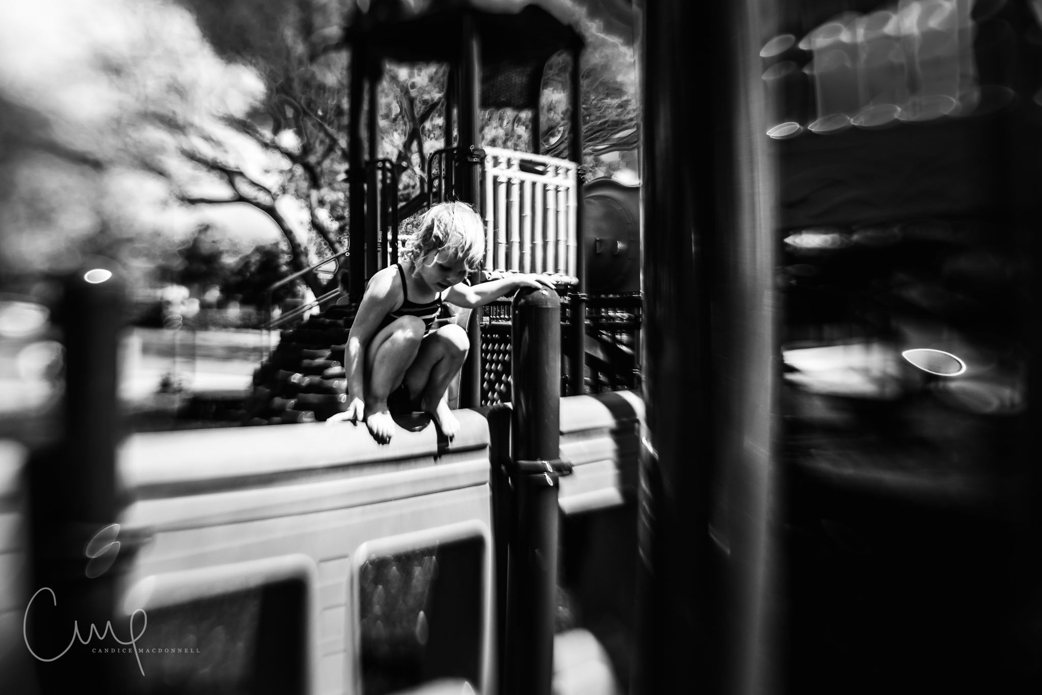 girl playing on playground distortion black and white oahu hawaii family lifestyle photography