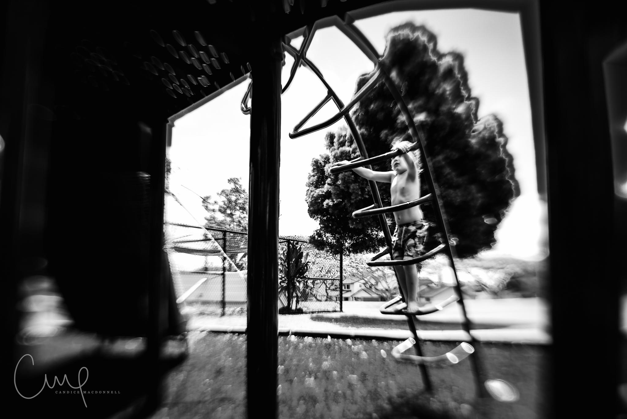 boy climbing on playground oahu hawaii lifestyle family photographer