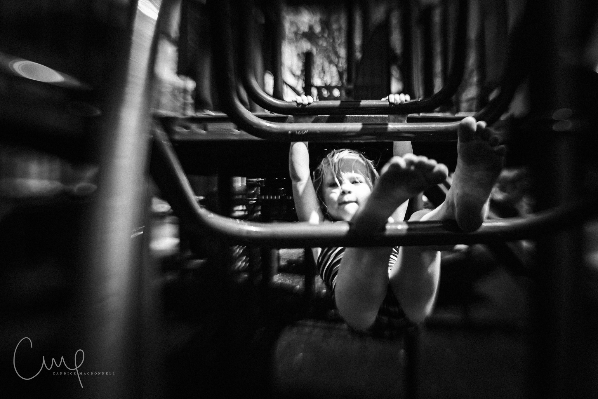 kid playing on playground black and white lensbaby oahu hawaii documentary family photography