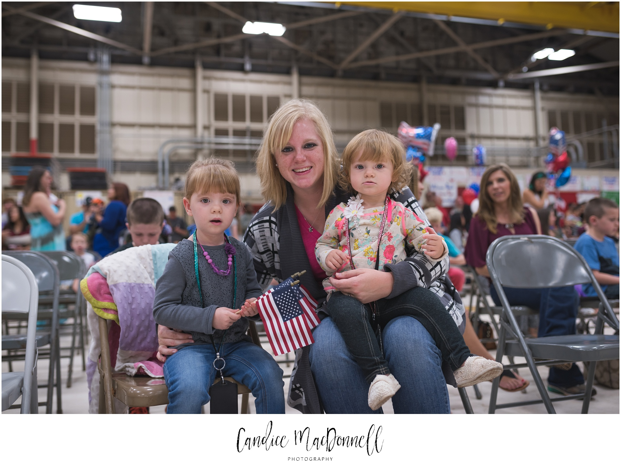 mom and daughters waiting for military homecoming welcome them home hawaii photographer