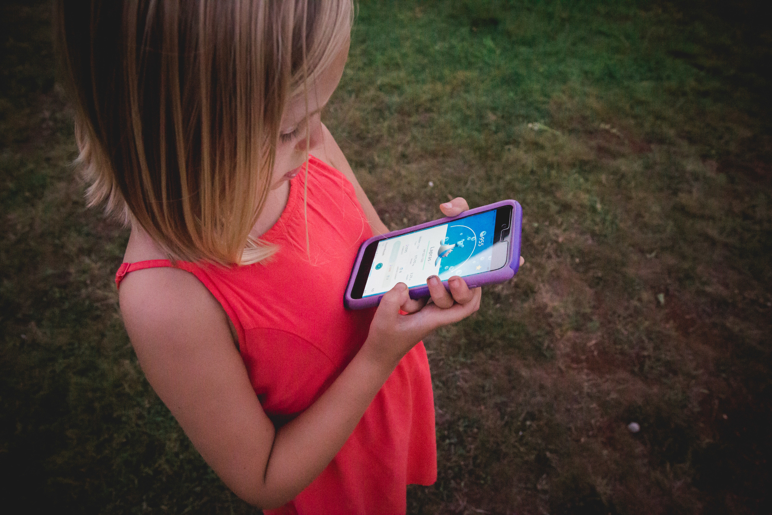 girl playing pokemon go showing off lapras