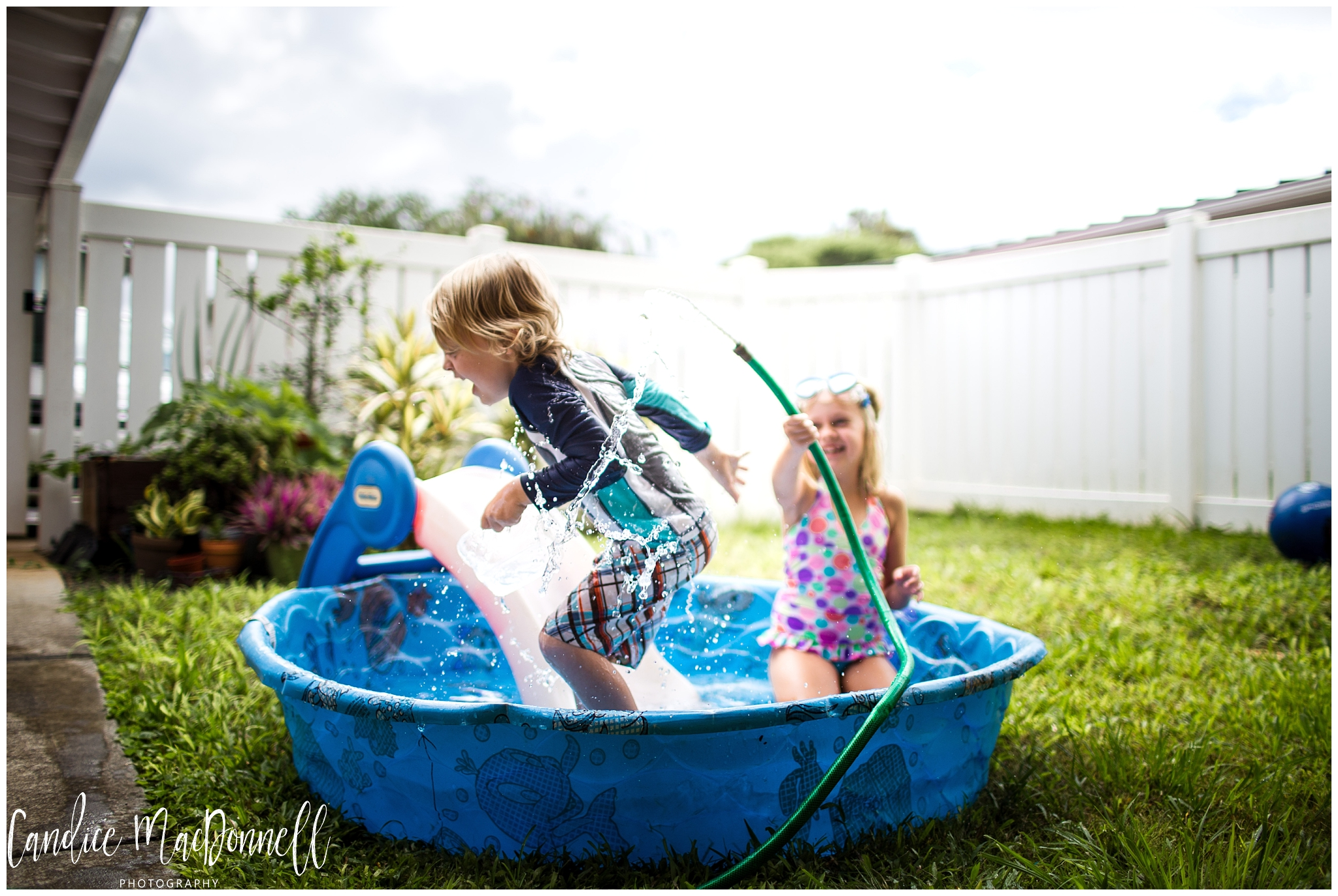 kids playing in pool in home hawaii photography