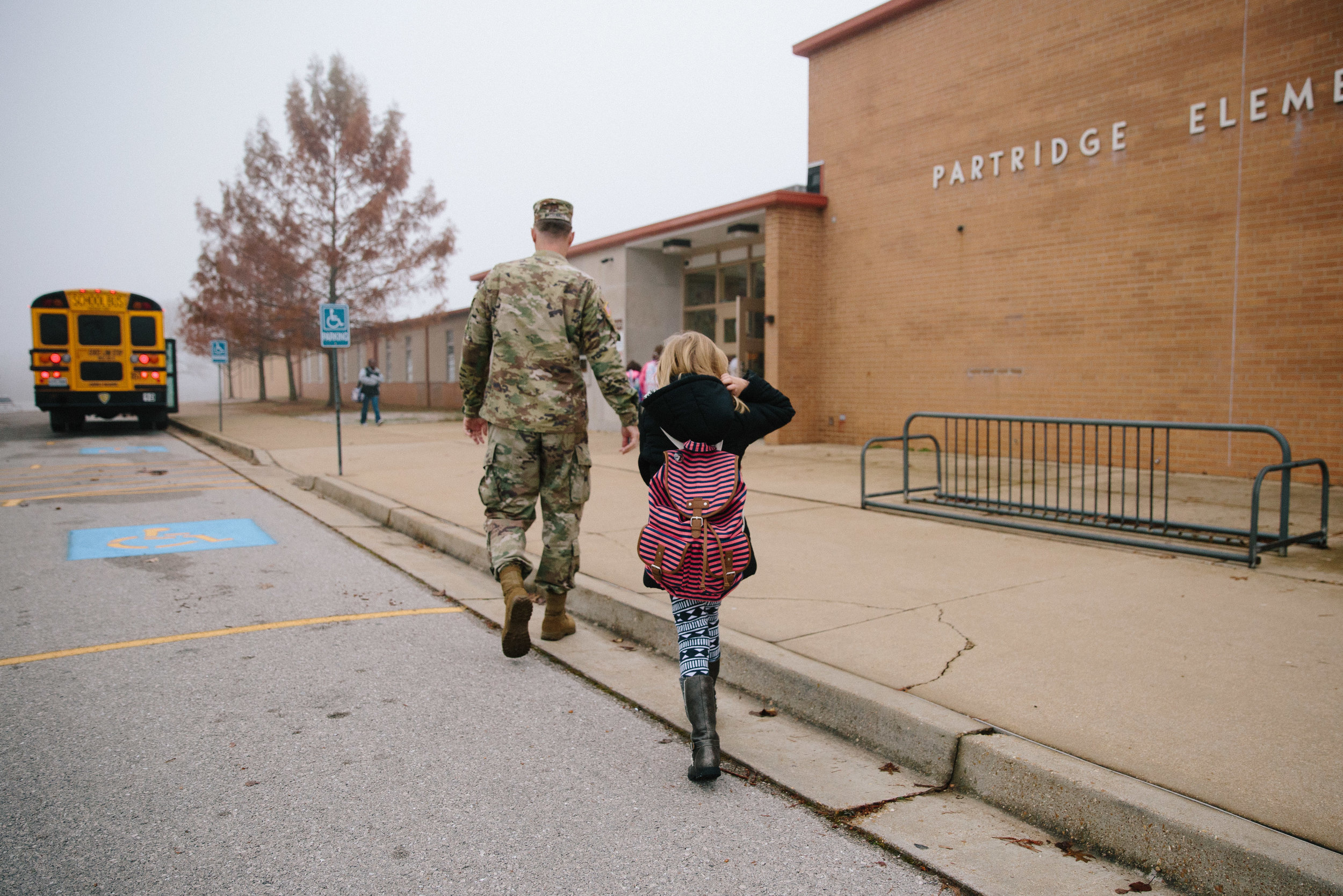 soldier walking daughter to class on first day of school - fort leonard wood documentary photography