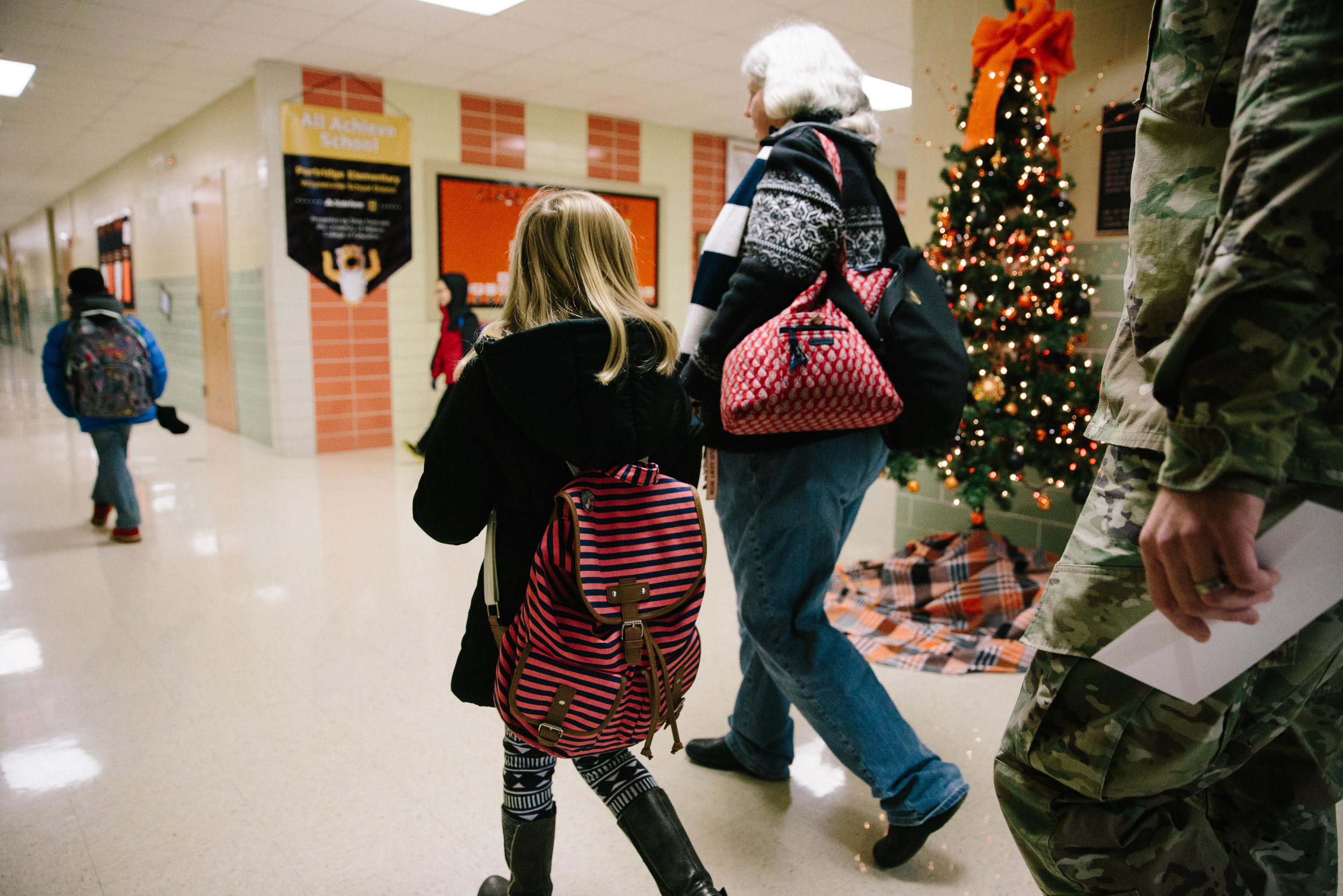 girl walking to class on first day of school - fort leonard wood documentary photography