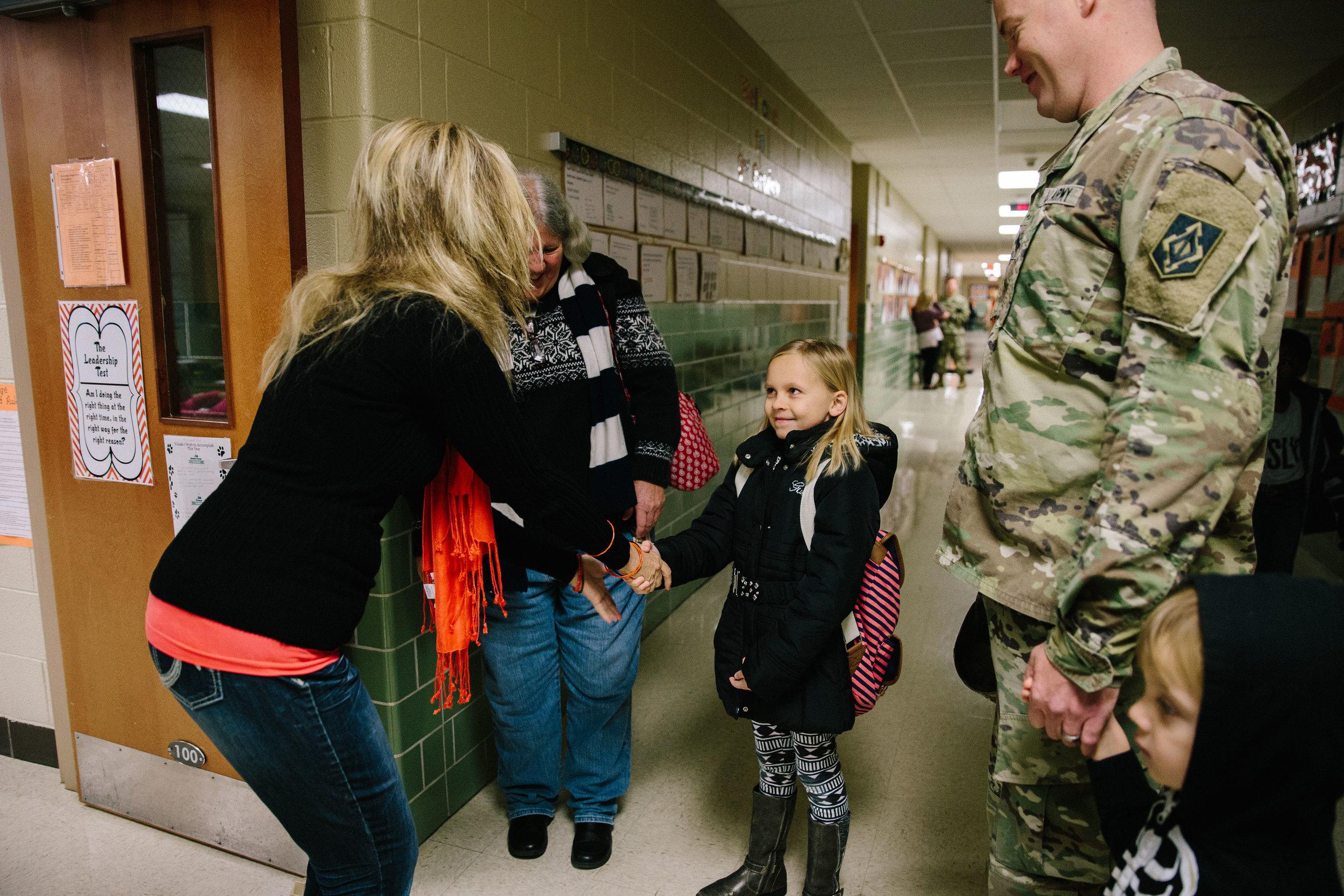 girl meeting her new teacher on first day of school - fort leonard wood documentary photographer