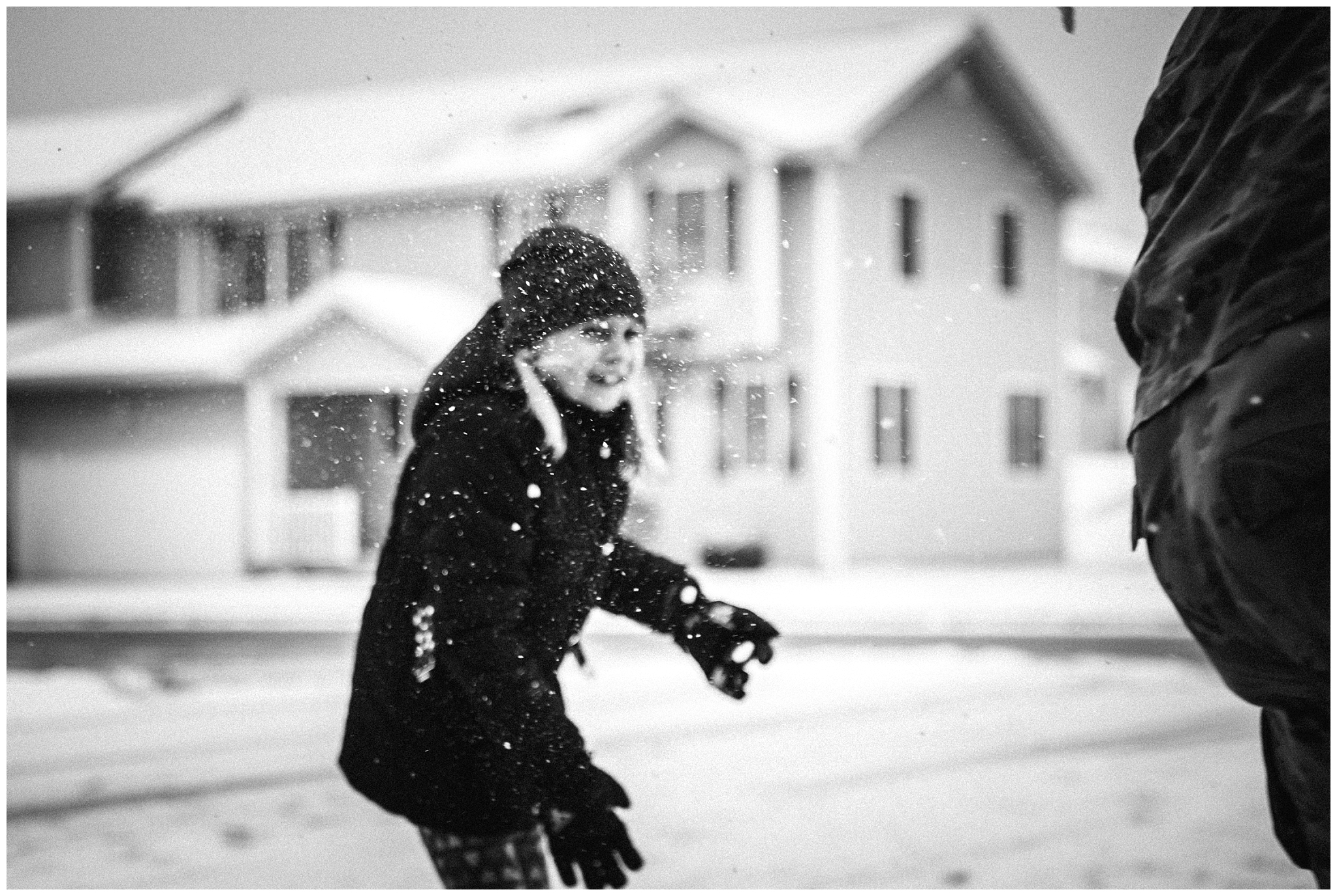 black and white lifestyle snow photo of little girl playing - fort leonard wood family photos