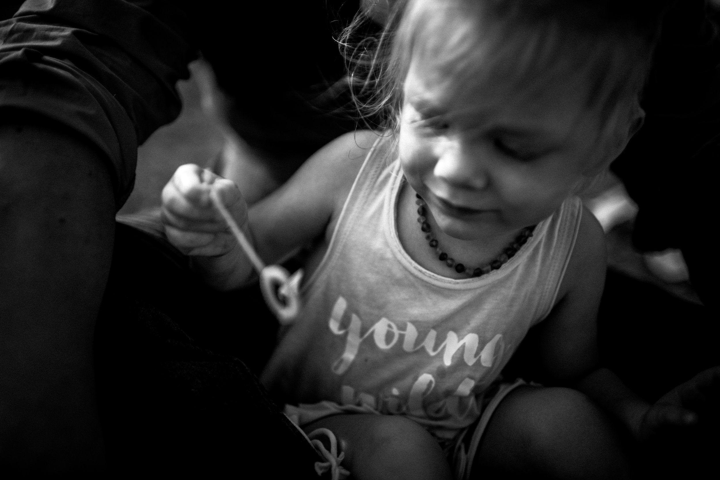 little girl blowing bubbles black and white lifestyle photographer