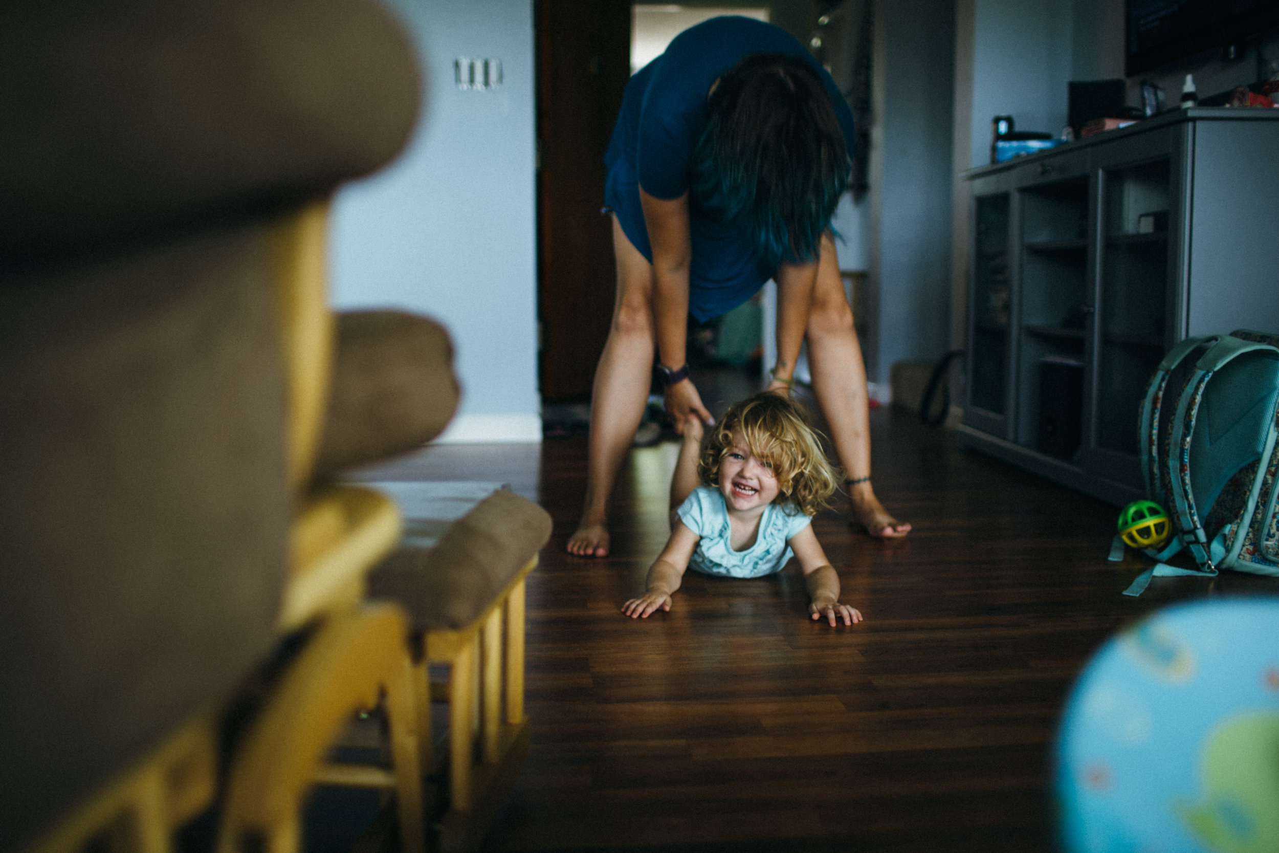 girl and mother playing in house lifestyle photography fort leonard wood MO