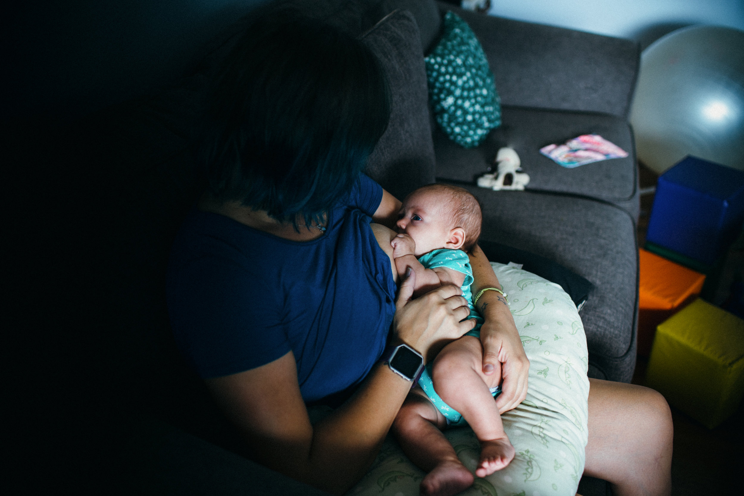 mother breastfeeding baby lifestyle photography in rolla missouri