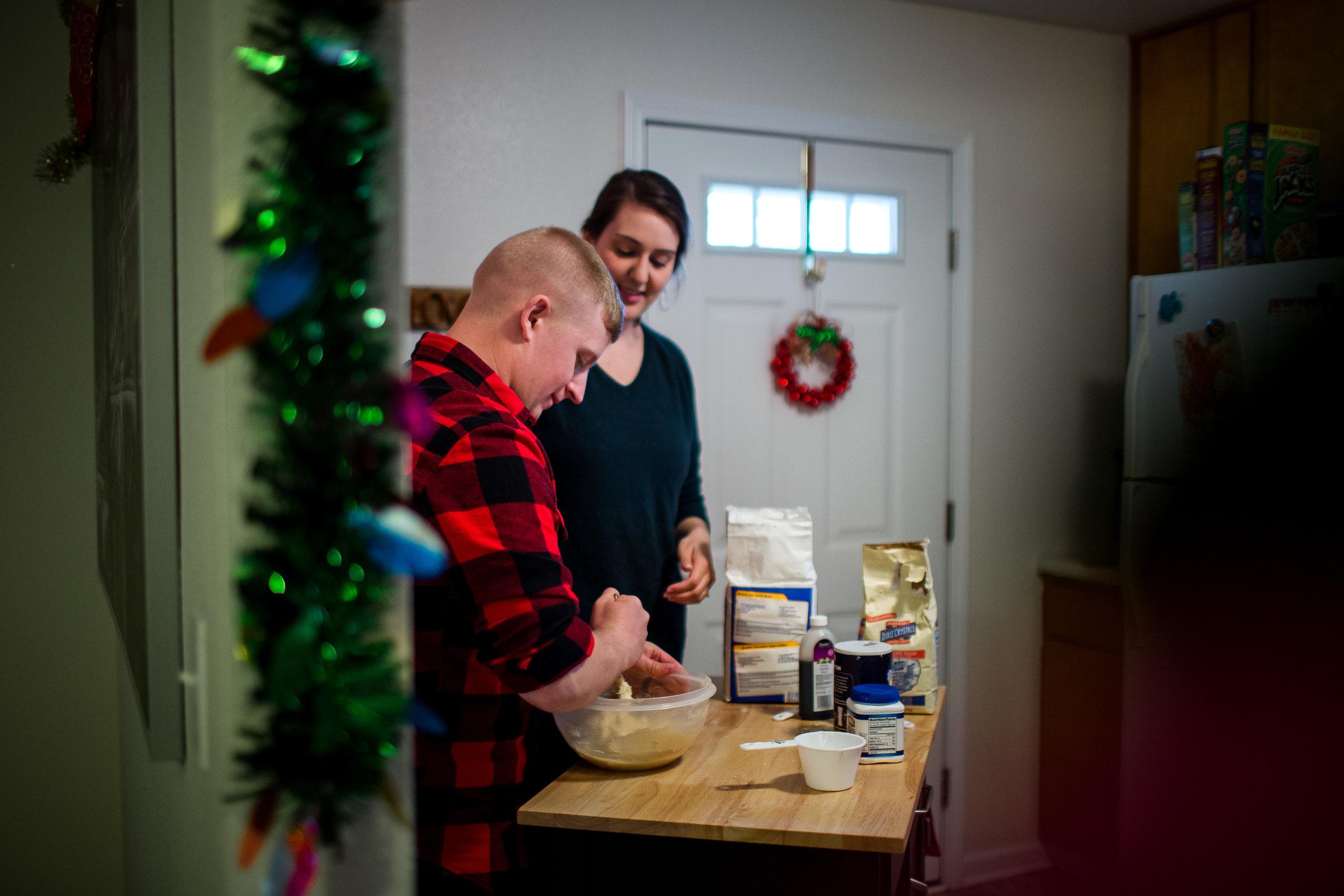 Christmas couples photos lifestyle baking cookies