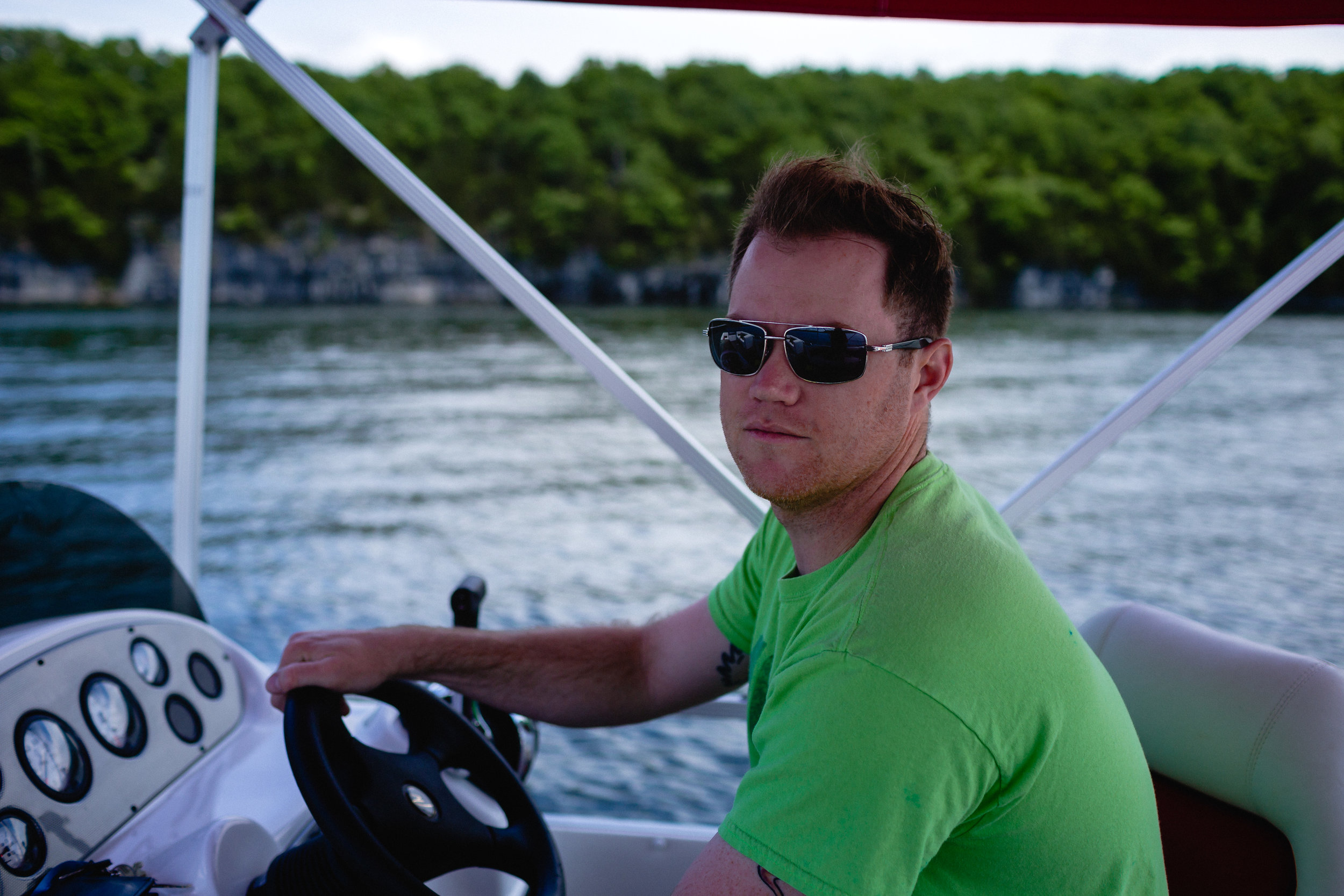man driving pontoon boat deployed husband fort leoanrd wood missouri photographer