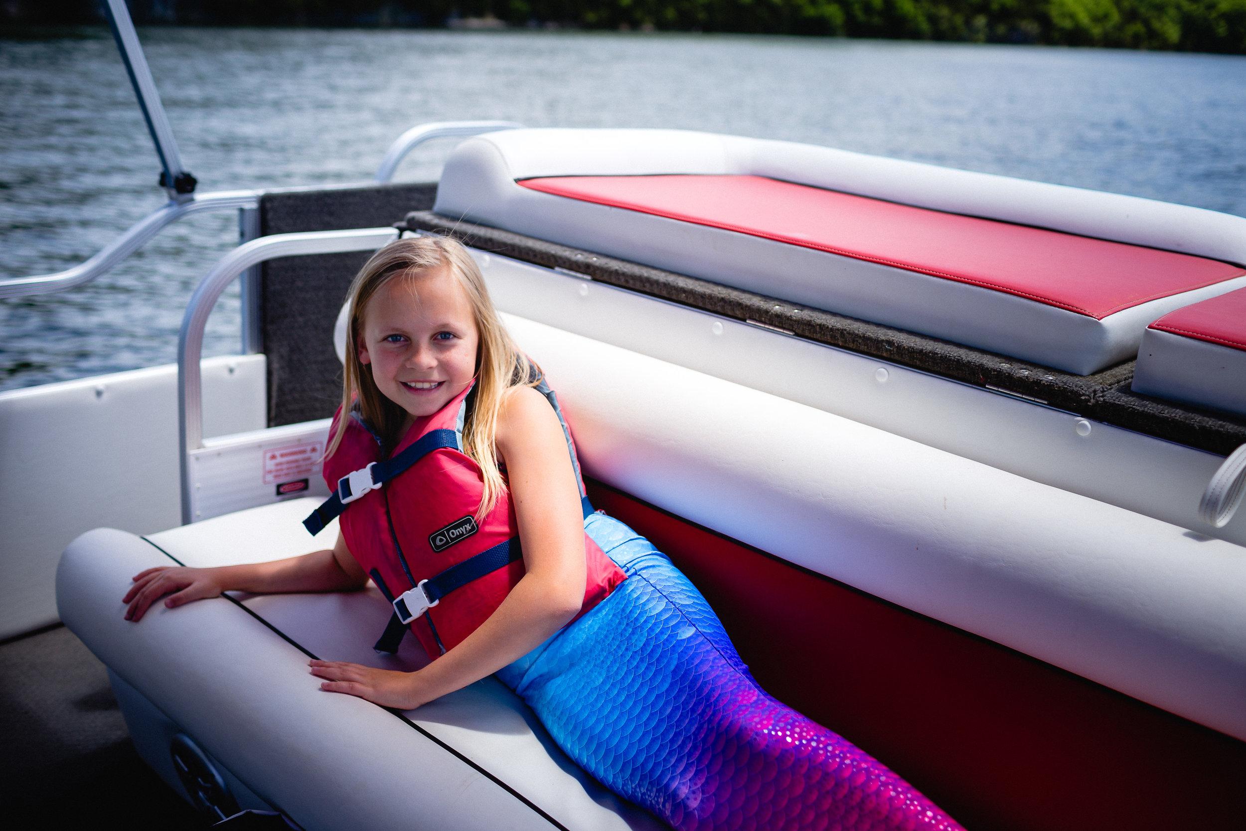 girl wearing fin fun mermaid tail waynesville photographer