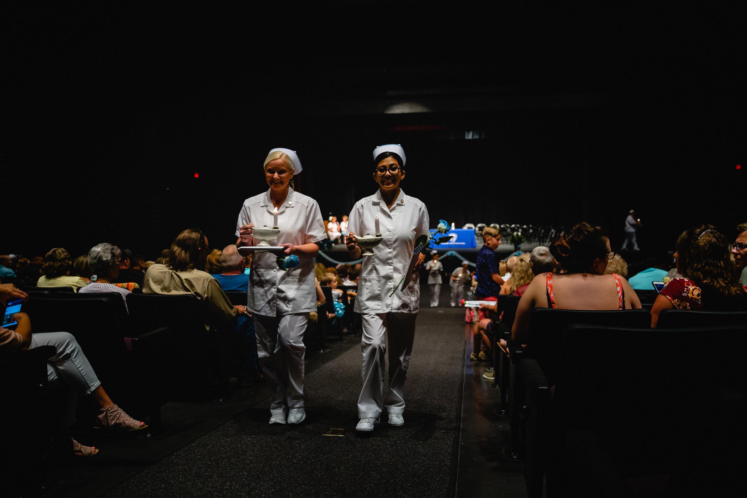 new nurse graduates walk aise at ceremony fort leonard wood photographer