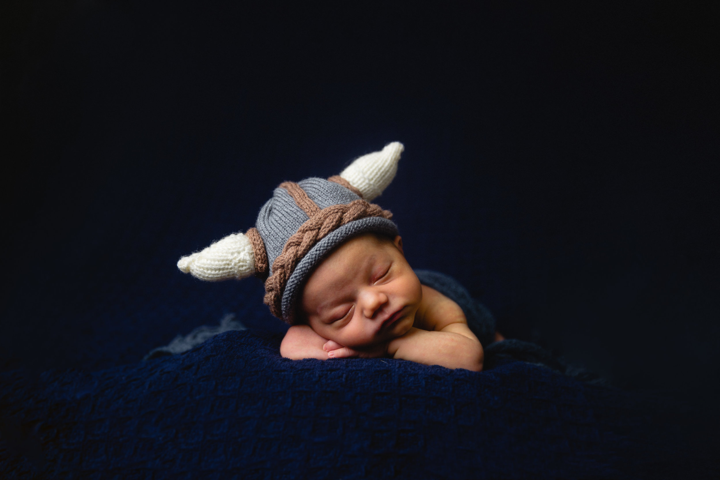newborn baby with viking knit hat on posing beanbag fort leaonrd wood photographer