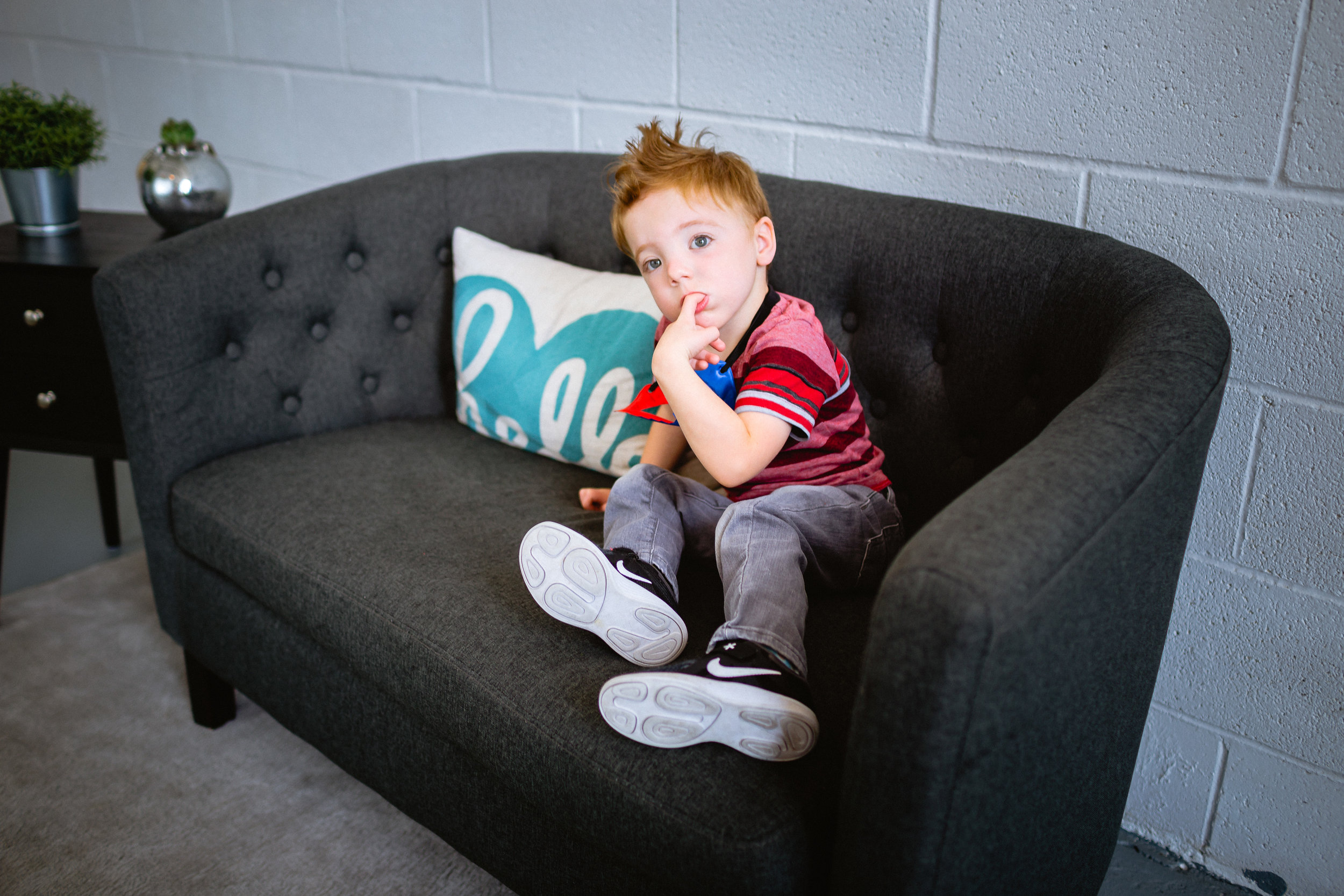 boy on couch lifestyle photography fort leonard wood
