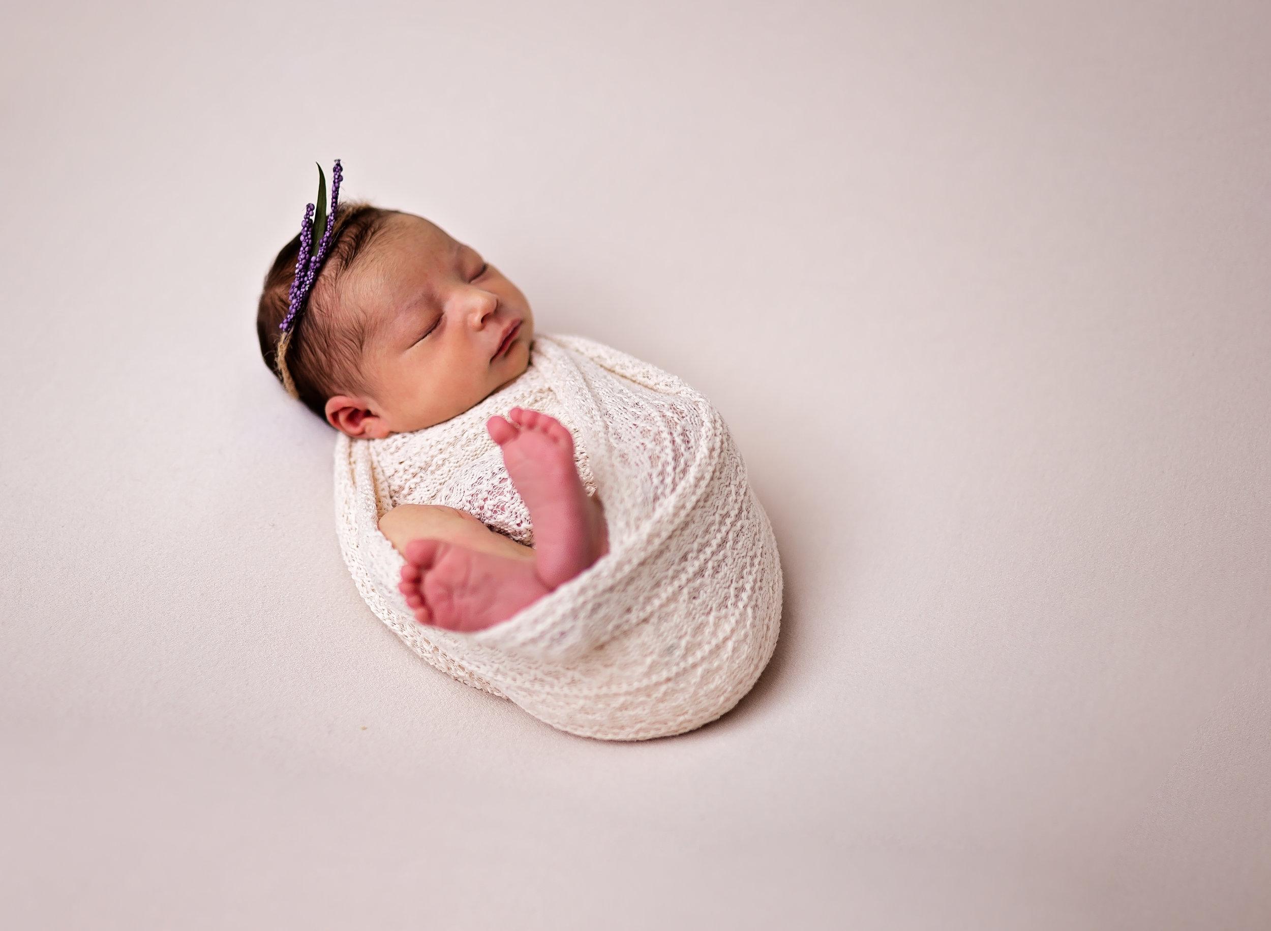 fort leonard wood newborn photography baby on cream fabric