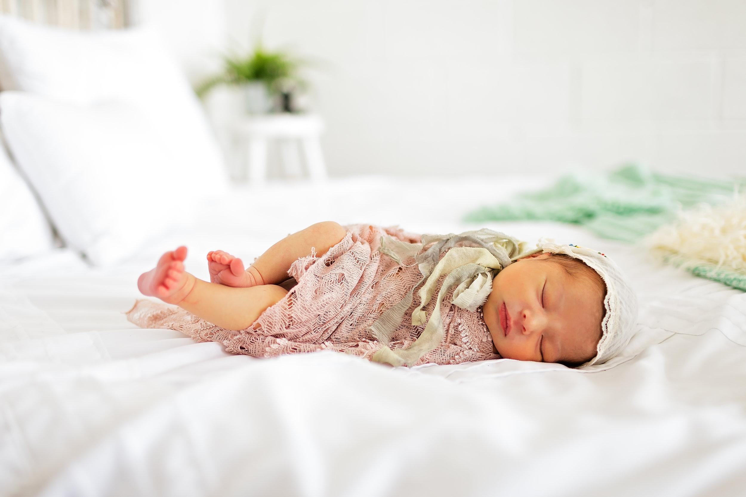 studio lifestyle newborn on bed waynesville photographer